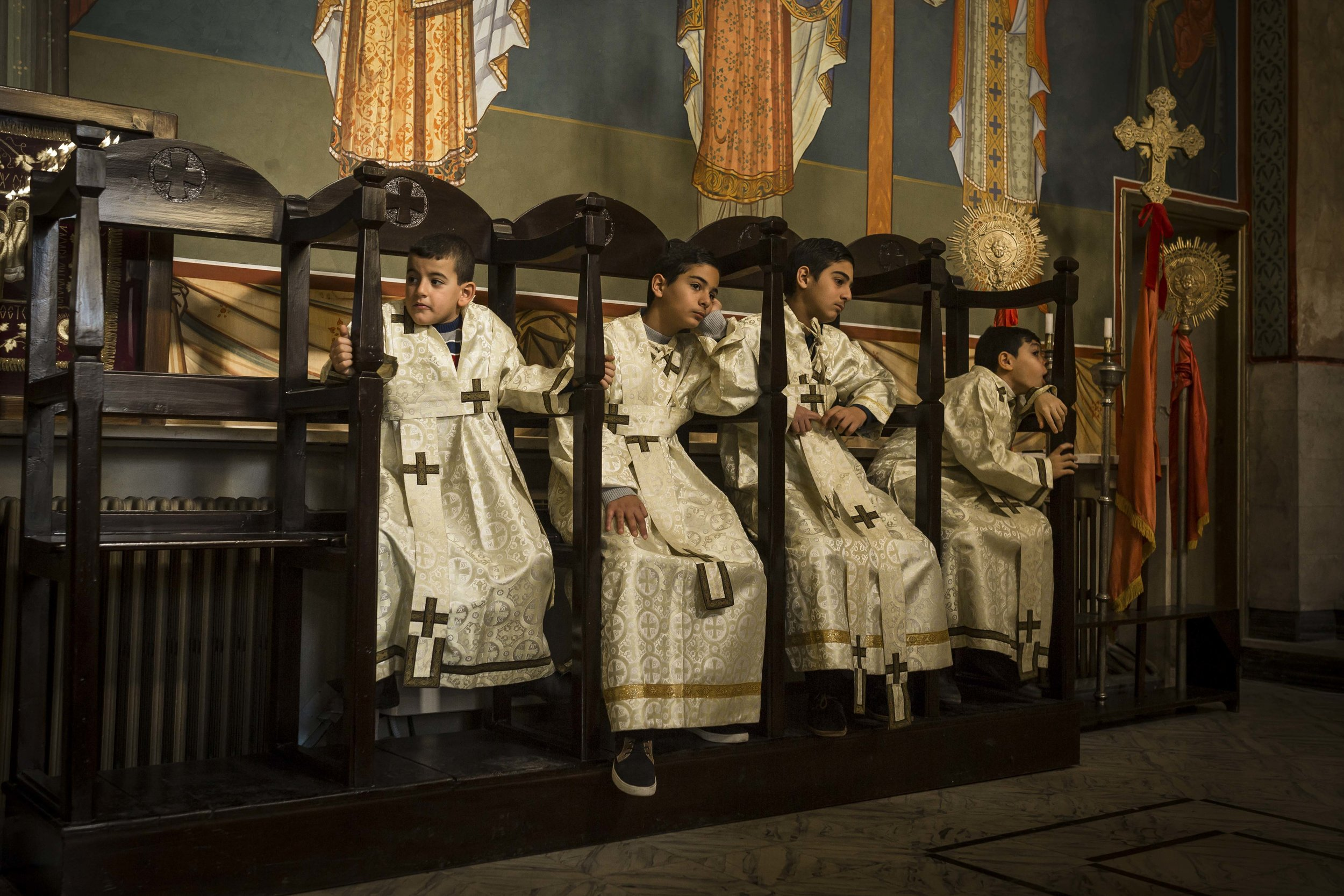 Young acolytes (altar service) taking part on a sunday mass in the Melkite Greek Catholic Church