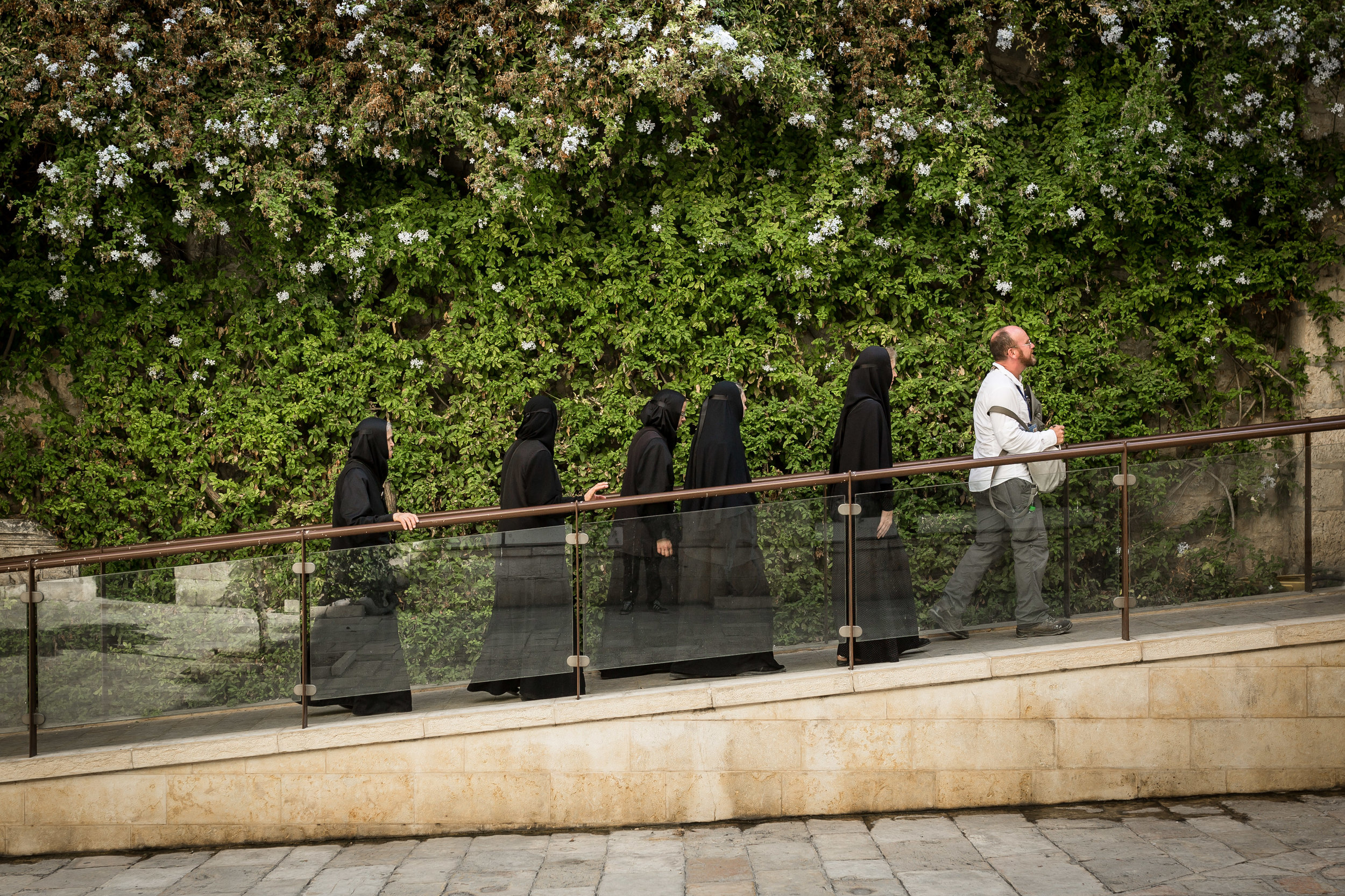 Nuns and a pilgrim seen near the first station of the Via Dolorosa in Jerusalem's Old City. The circuitous route is believed by many to follow the path that Jesus walked, carrying his cross, on the way to his crucifixion.