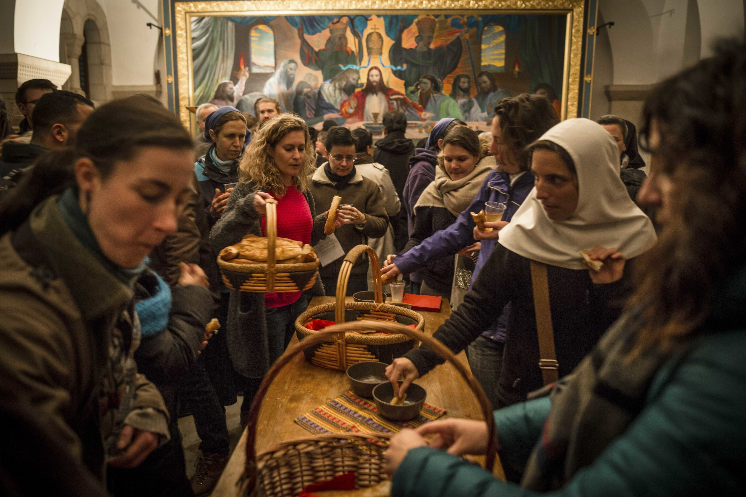 Pilgrims take place on a dinner after a evening mass in the Domicio Abbey on Mount Zion near Jerusalem's Old City