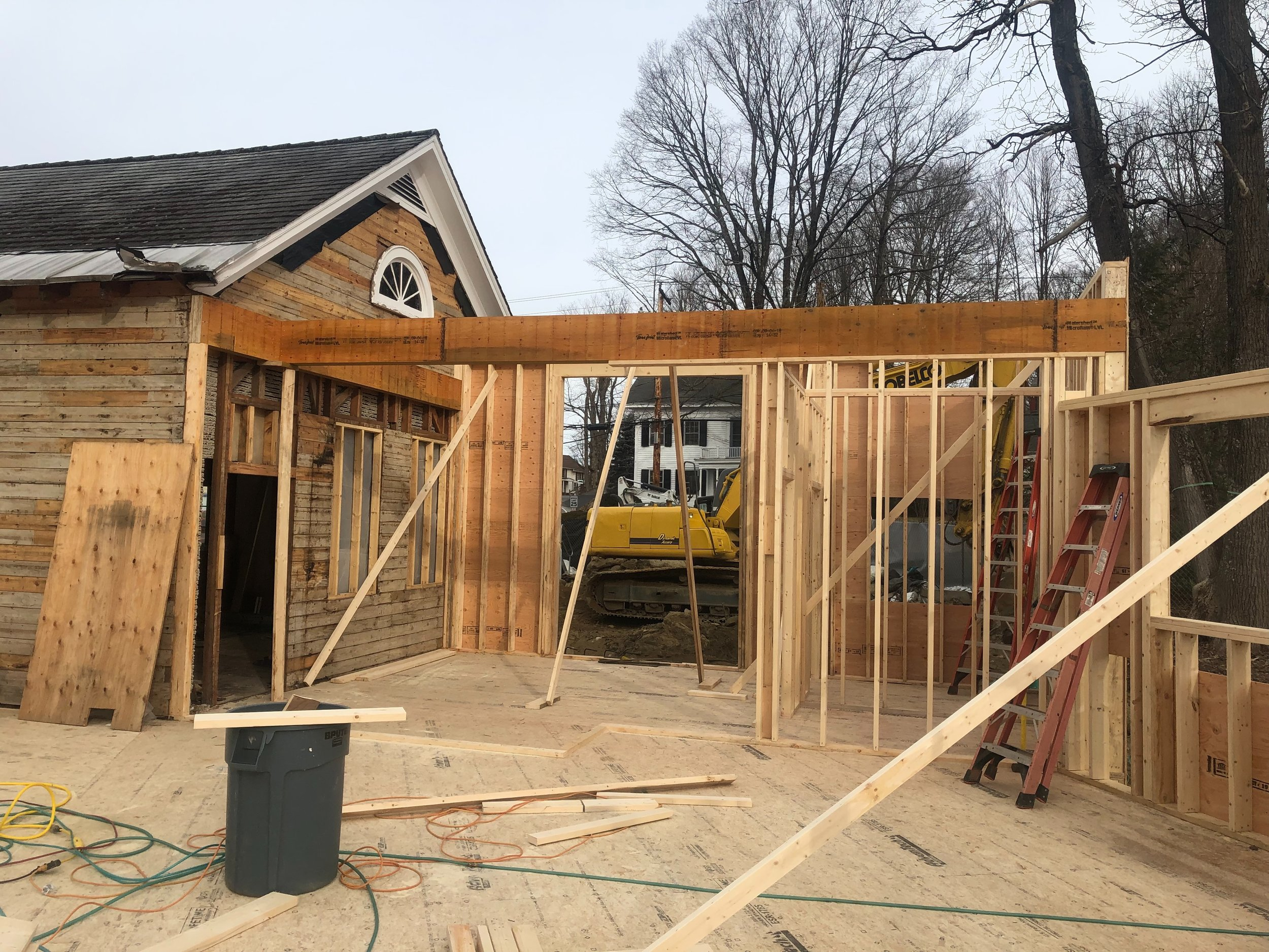 STRUCTURAL BEAM SUPPORTING CEILING AND ROOF OVER ENTRYWAY