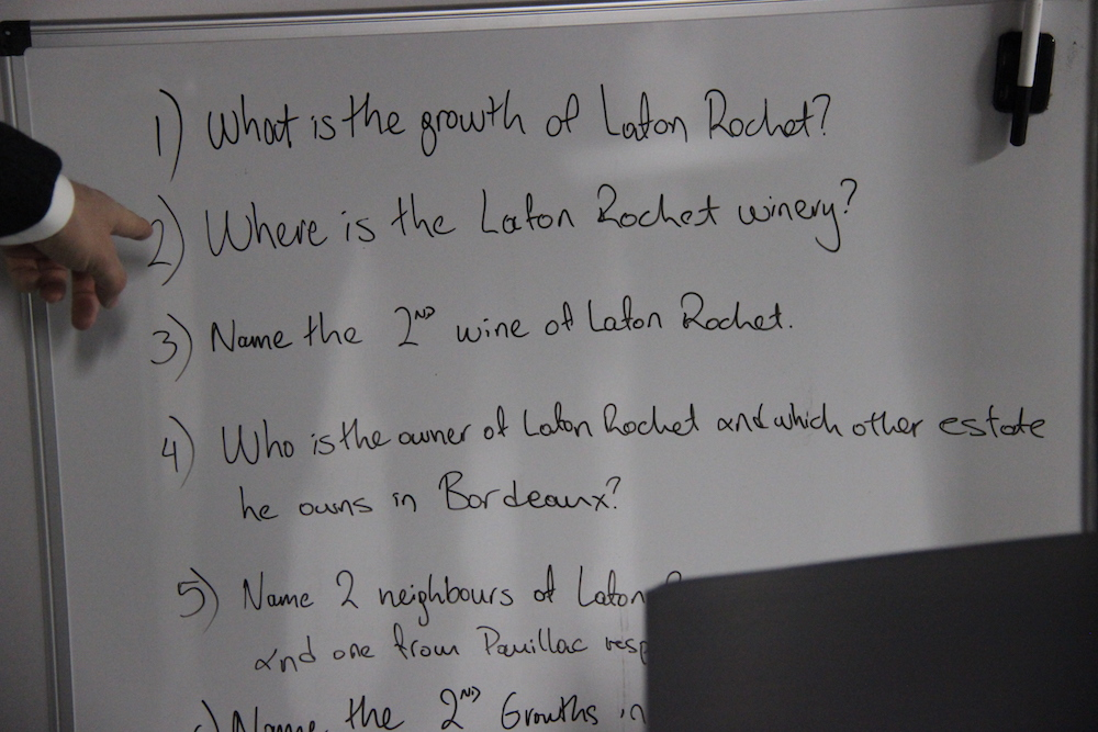 Questions for the staff to learn for a Lafon Rochet dinner, featuring the pointing finger of its owner, Basile Tesseron