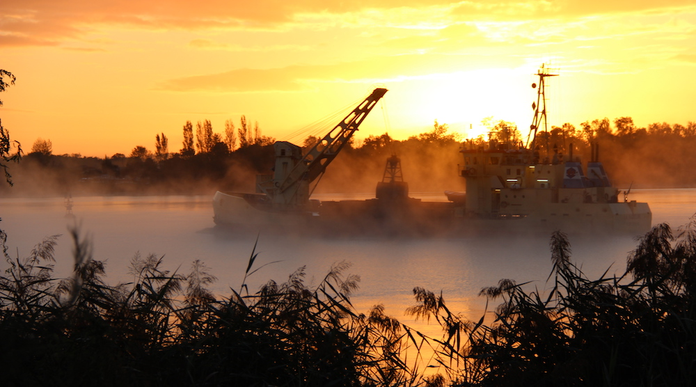 A boat in early morning mist on the Dordogne in Bordeaux, September.