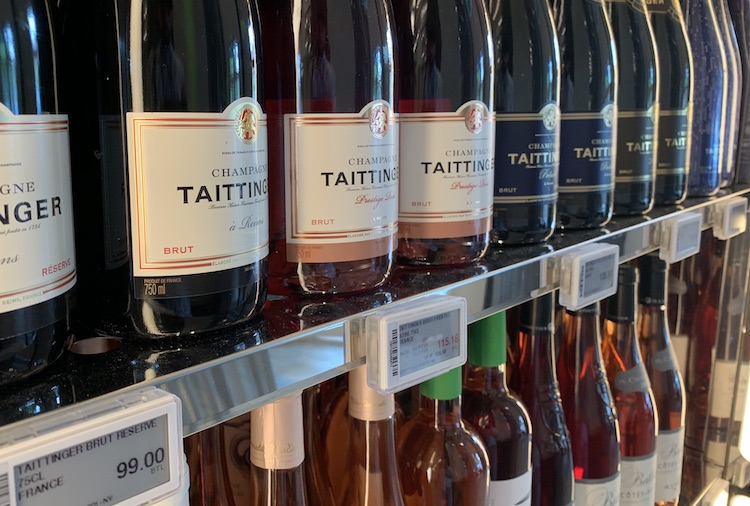 Taittinger NV at $99 is £60; it costs  £30 at Lay & Wheeler