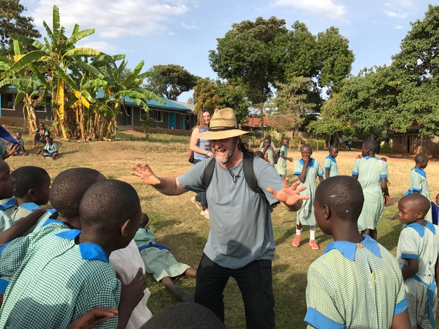 Dennis playing with kids at the public school.