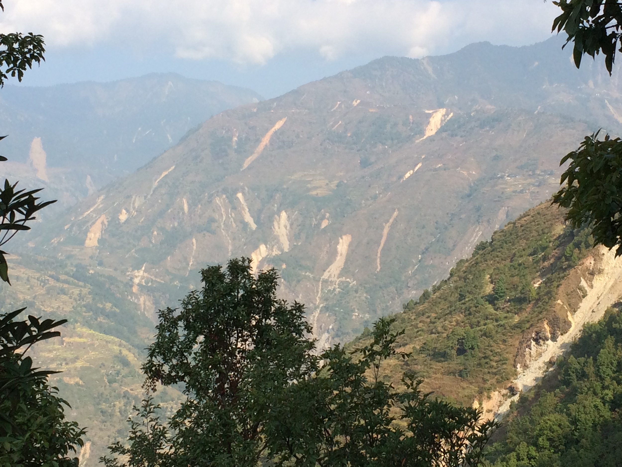 The hillsides surrounding Gati are scarred from deadly landslides of the past