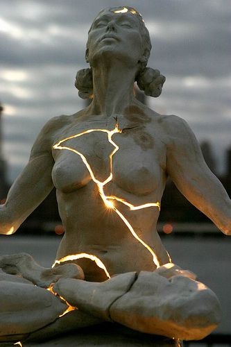 meditating woman with light from within.jpg