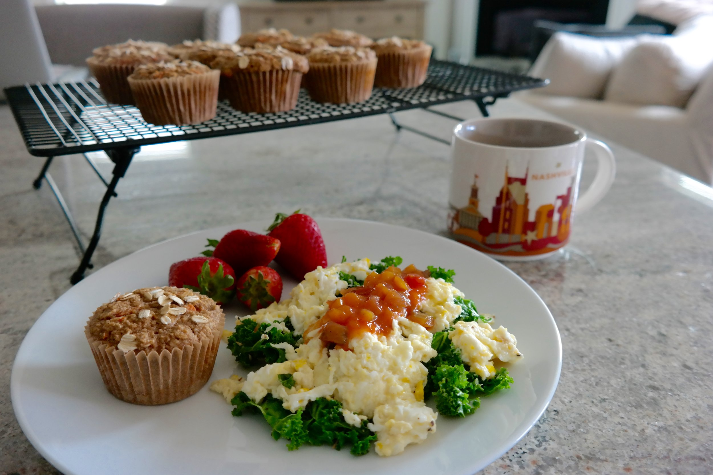 One of my week 1 breakfasts from Spring 2018 Fat Loss Cooking School! A big egg scramble with 1 whole egg, 3 egg whites, a big handful of sautéed kale, a little goat cheese topped with peach salsa. Side of berries and one of these AMAZING Carrot Spice Applesauce Muffins! HAPPY LAQ!
