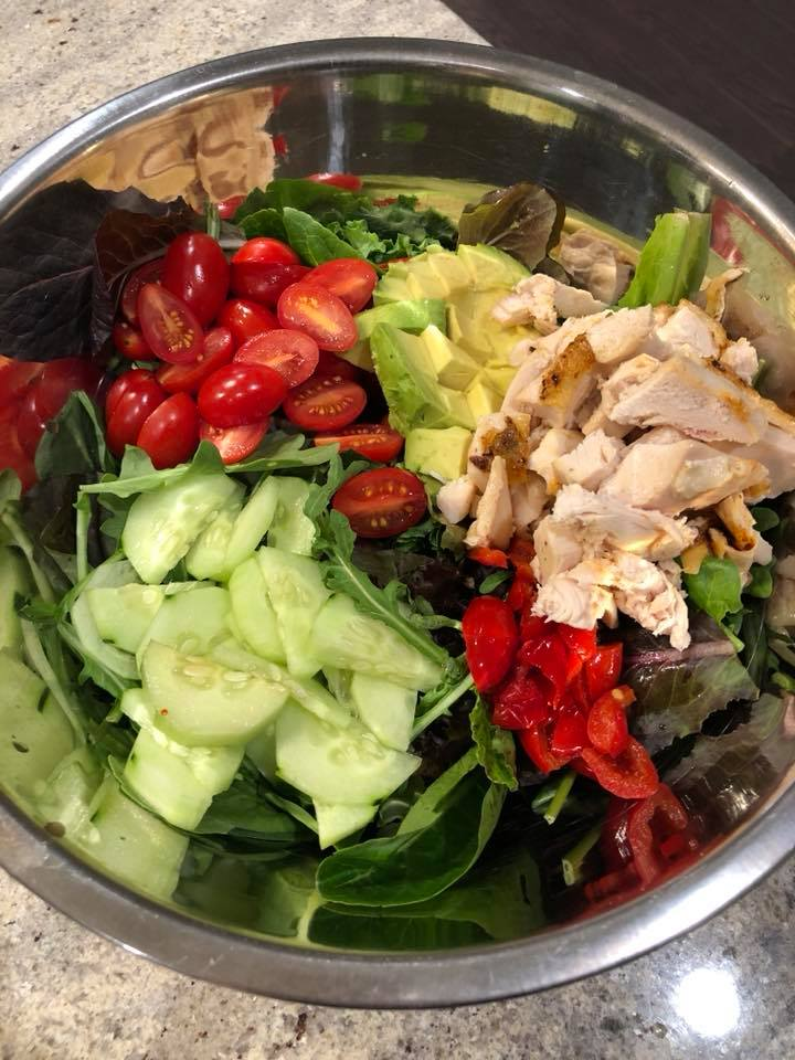 Dinner Salad for 2 after our first shopping trip to Sprouts: mixed greens, cucumber, grape tomatoes, cherry peppers, avocado, rotisserie chicken. Seasoned with salt & pepper and tossed with Tessemae's Habanero Ranch.