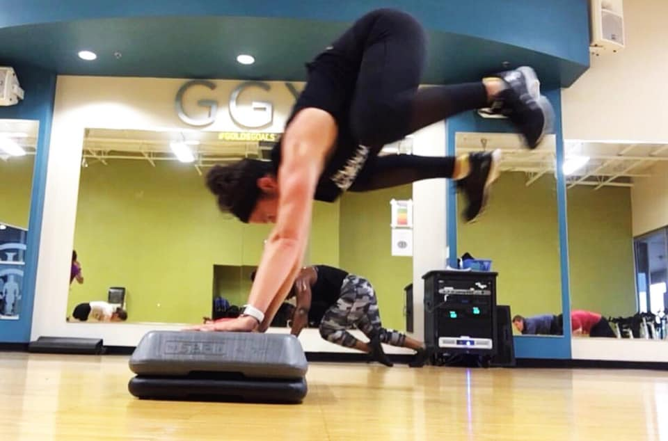 Katelyn kicking Les Mills GRIT in the face with a donkey kick. Adding this 30-minute High Intensity Interval Training workout to her routine was part of Katelyn's lifestyle change.