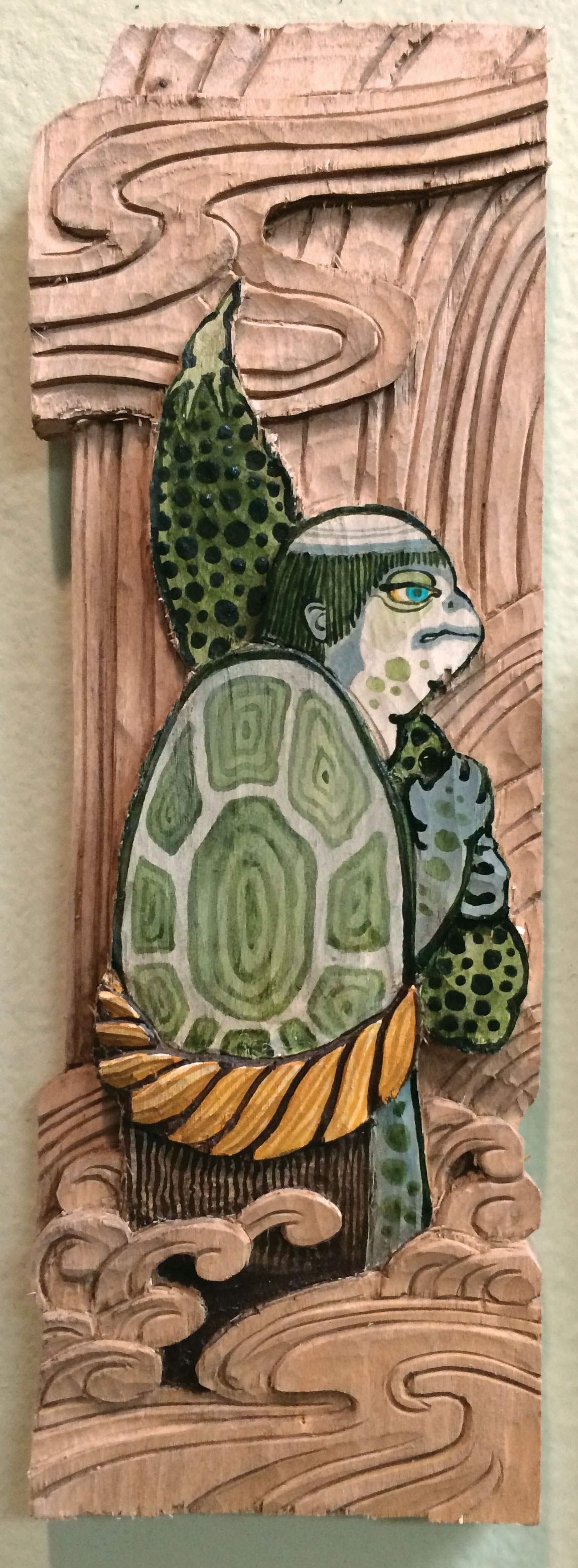 "Kappa brings dinner.  2014 - acrylic and hand carved wood. 9"" x 3""."