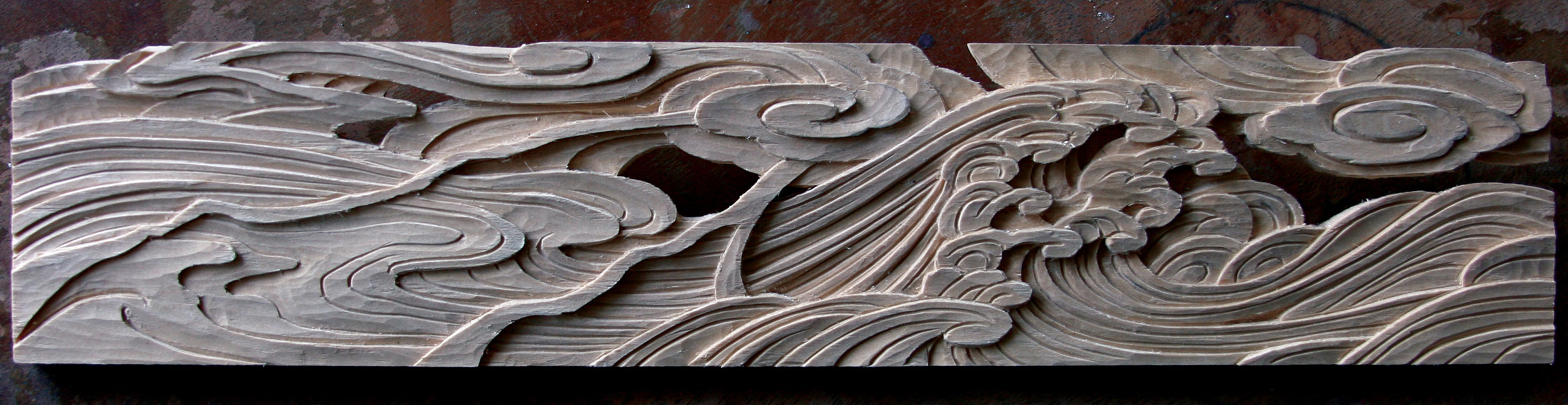 "Untitled (storm at sea).  2013 - hand carved wood. 3"" x 13""."