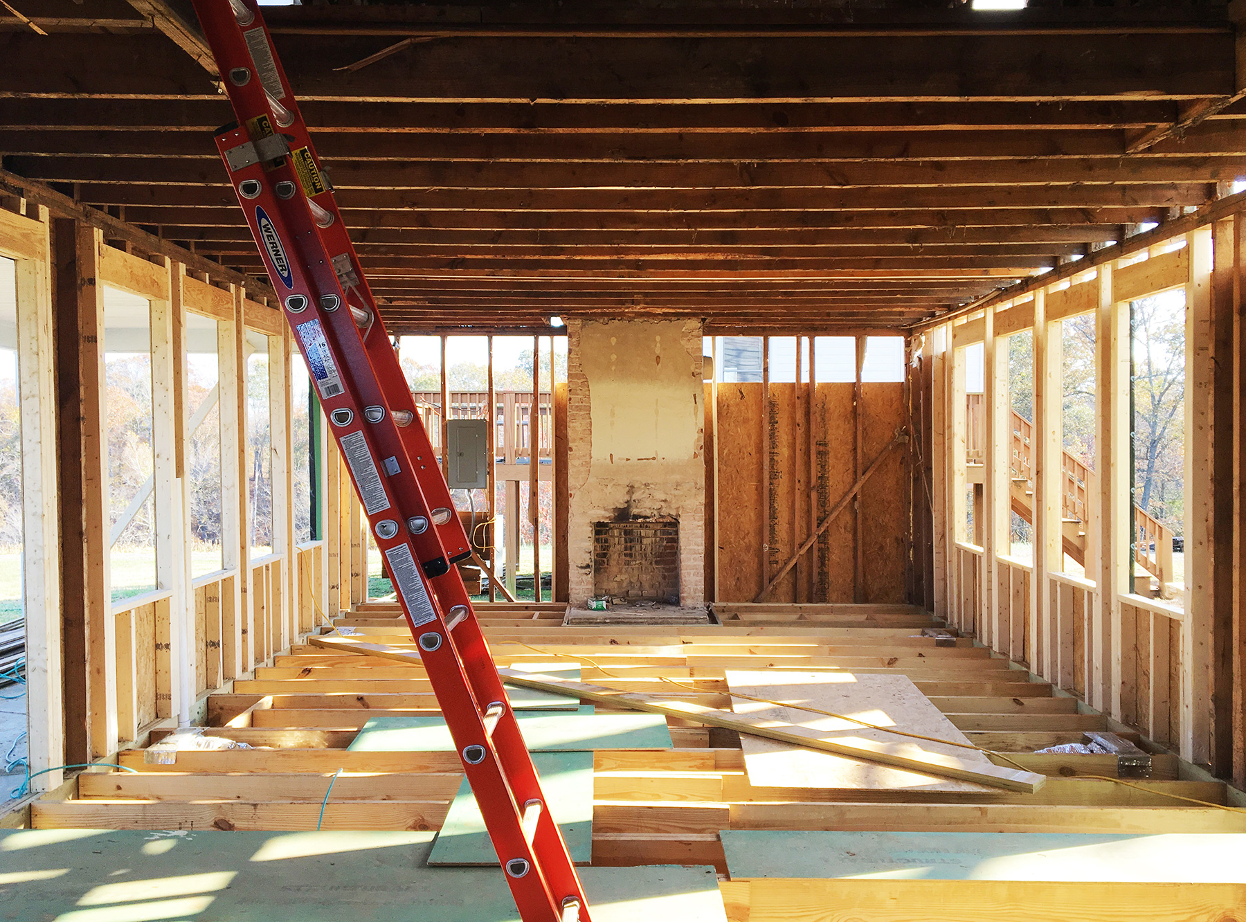 THE WALLS WERE REFRAMED AS REQUIRED FOR NEW WINDOWS AND ADDED STRENGTH; THE SECOND FLOOR WAS REINFORCED WITH LAMINATED VENEER LUMBER.