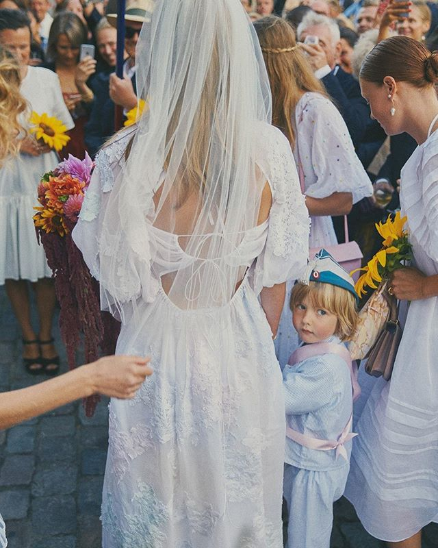 "Model @caroline_brasch took the canal boat to her wedding in Copenhagen. ""Everything was done DIY by the people closest to us, some of whom are artists, florists, and architects,"" Caroline says. ""The whole idea was to keep it fun and down-to-earth, unconventional, and happy."" Read the whole story at @voguemagazine ~ Photo by @rasmuswengkarlsen #adornmentinspo"