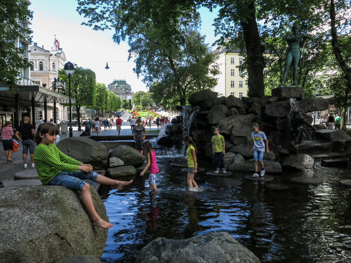Kids cooling off at a fountain near city center