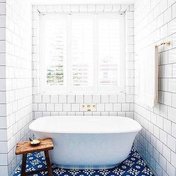 m_blue-mosaic-bathroom-floor-tiles-gold-wall-mount-tub-filler.jpg