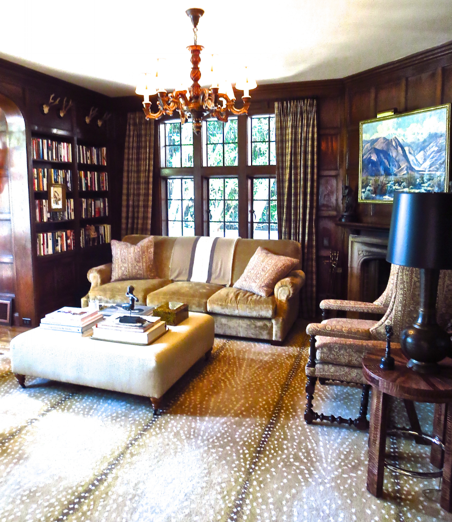 library-sofa-living-room-wood-paneled-walls-cococozy-tudor-house.png
