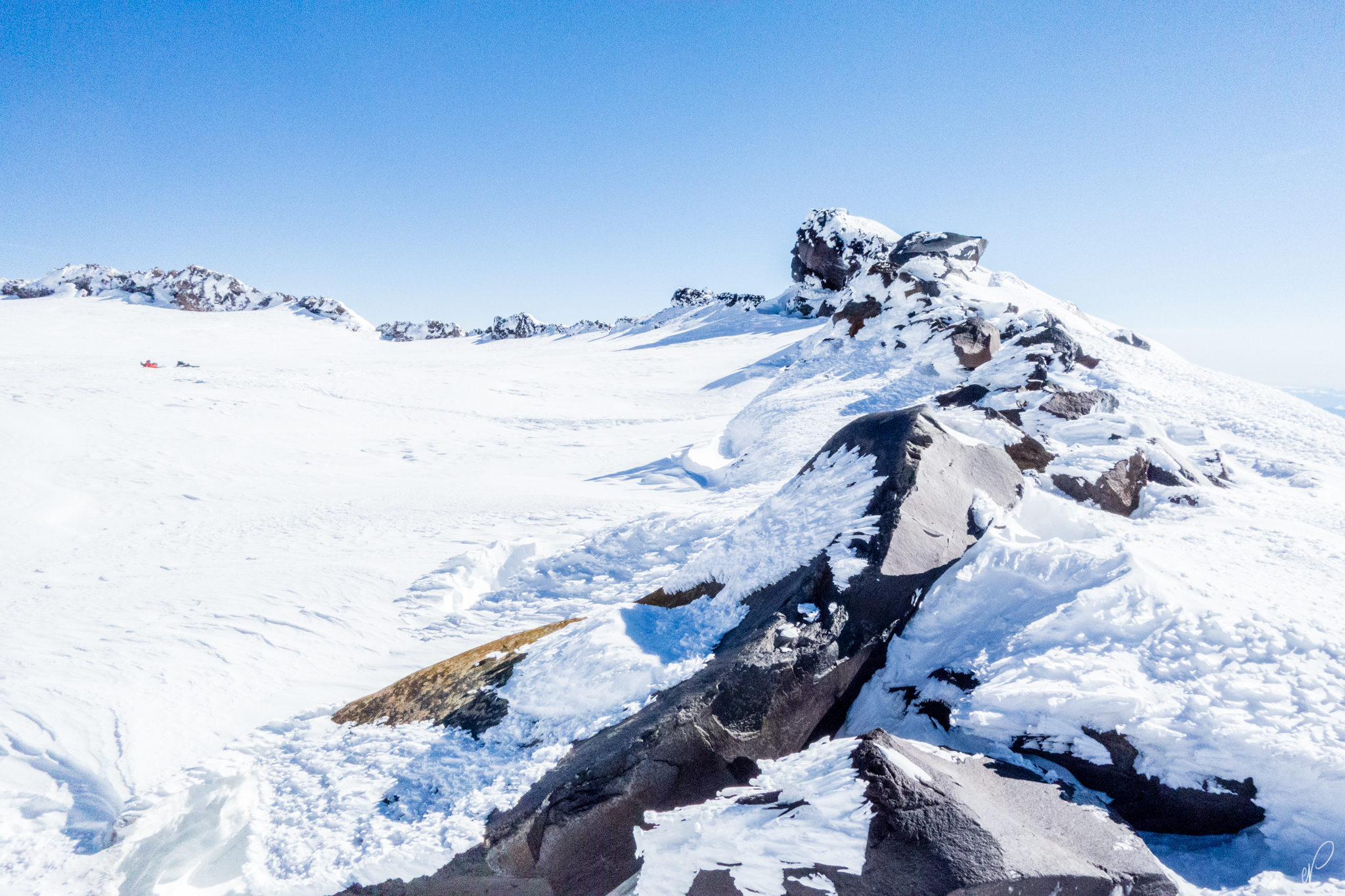 The first sign of rock.The crater rim, and the Summit of Rainier