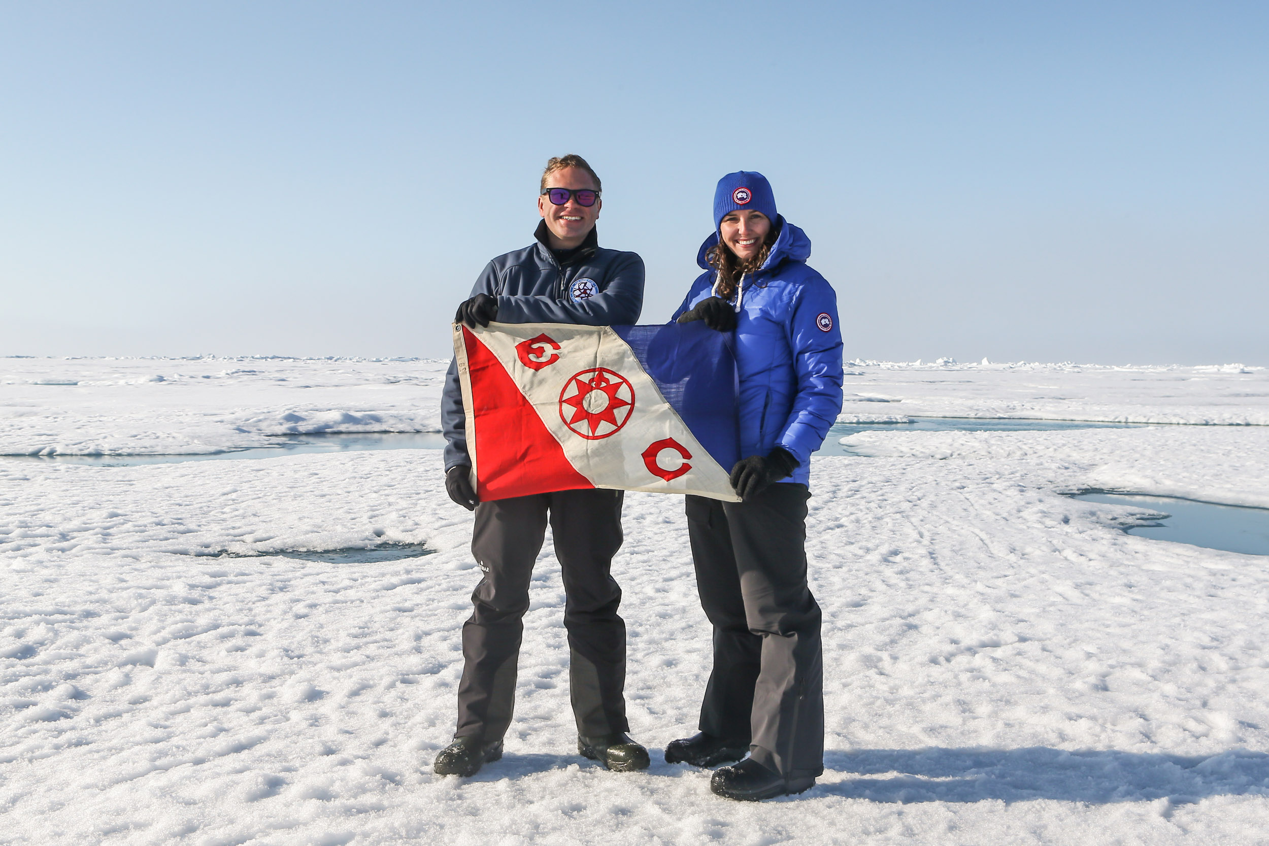 Lauren and Alex at The Geographical North Pole with Explorer's Club Flag #69