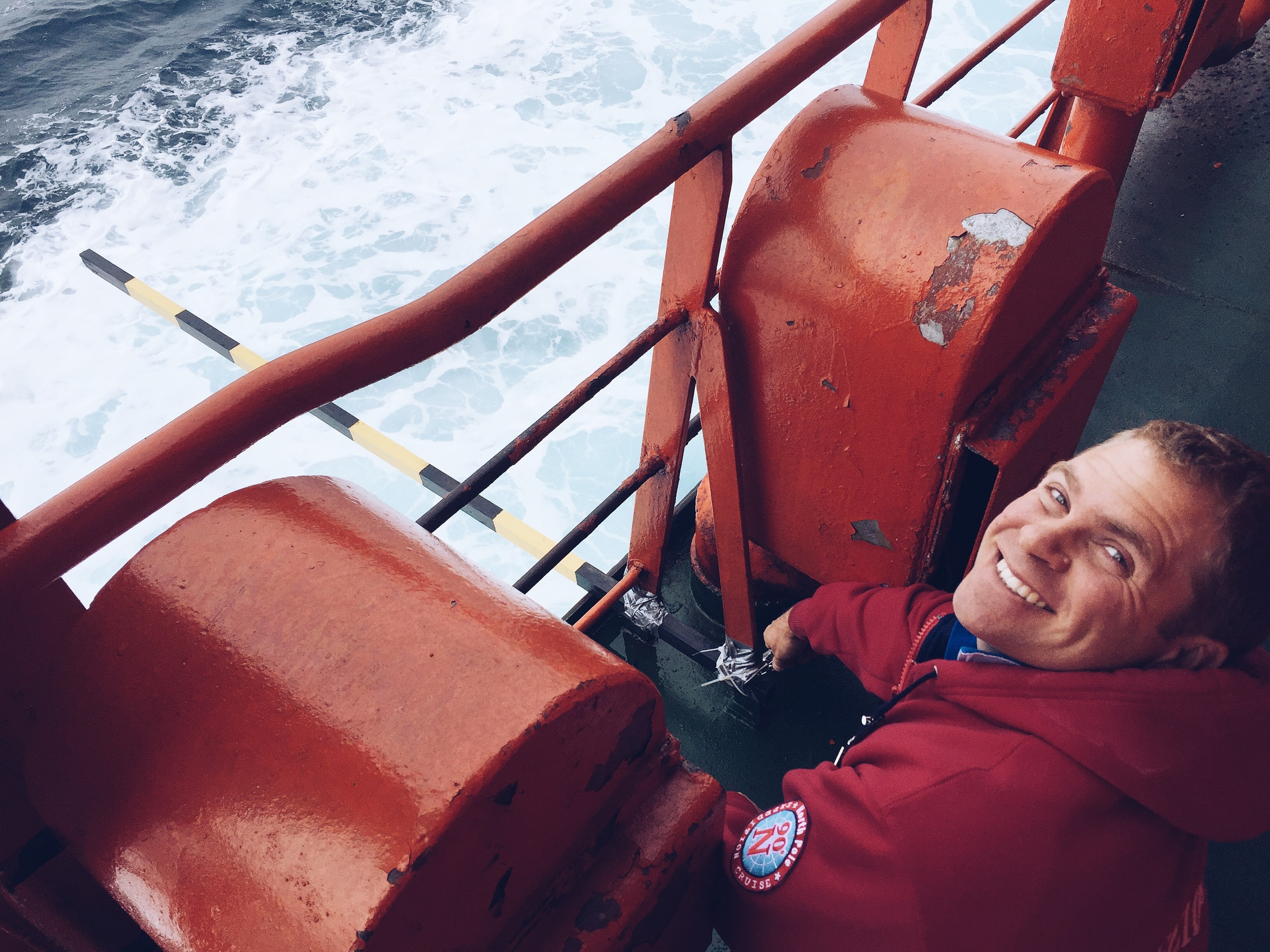 Working in the Barents Sea, affixing a ruler to the ship's side to help accurately estimate ice thickness as it breaks and overturns next to the ship