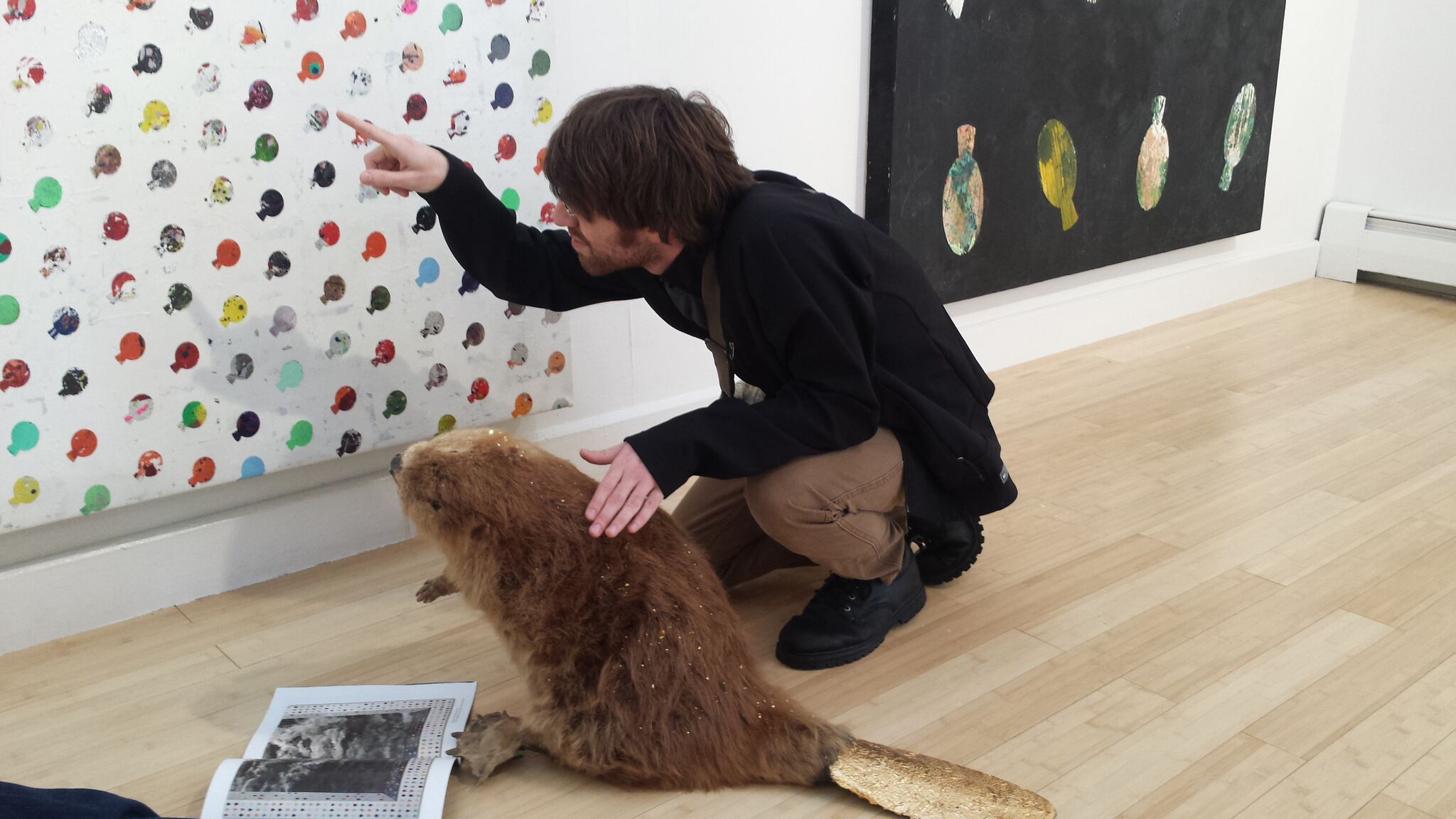 Alum Ben Frost (Class of 2013) explains the symbolism of Jung Hur to the UMF Beaver.