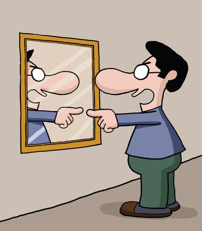 [image description: cartoon image of a person standing in front of a mirror, angrily pointing at the mirror. The person is wearing green pants, a blue shirt, and glasses. They appear to be blaming and yelling at their own reflection. Image found on  The Barefoot Spirit .]