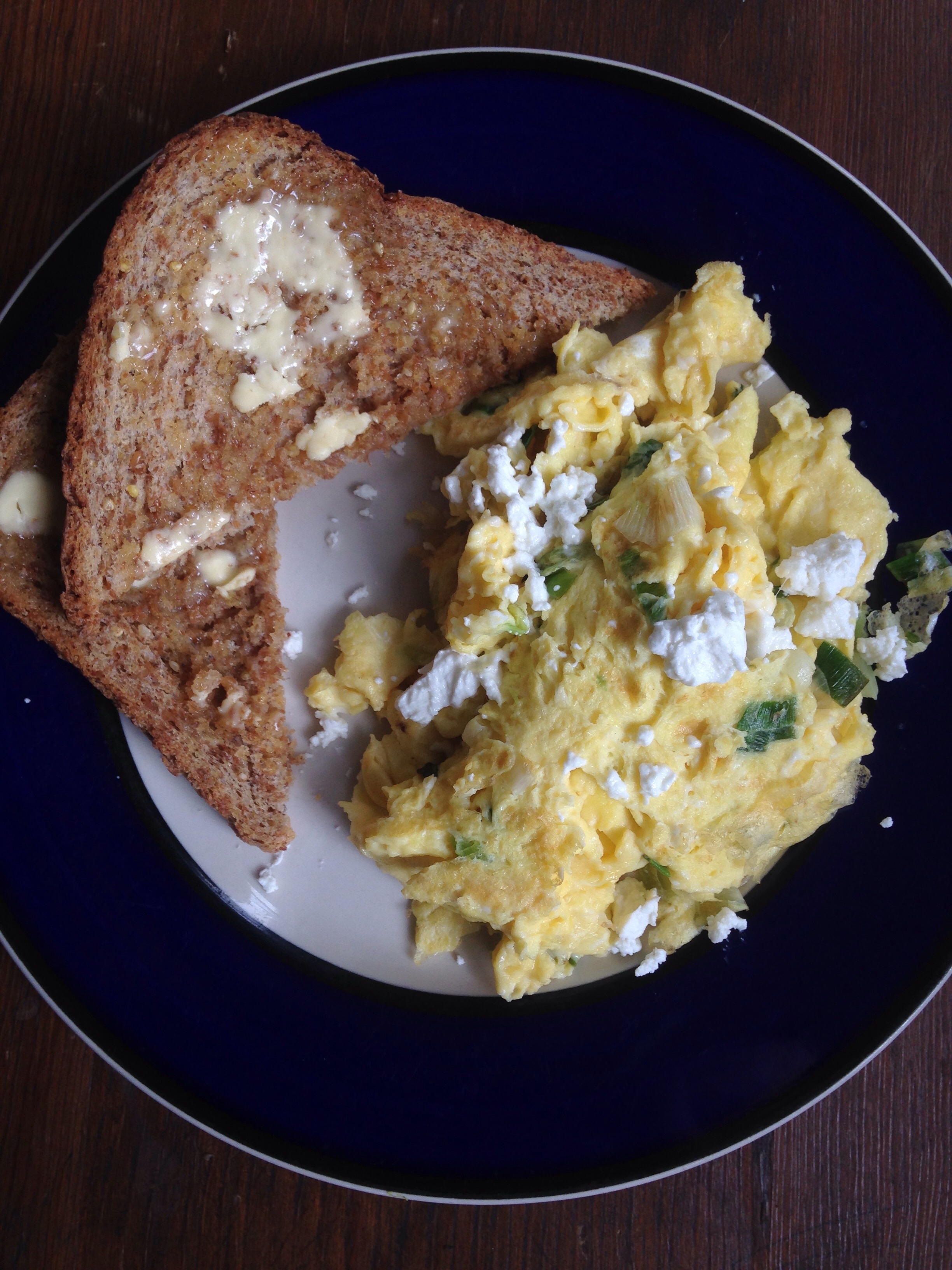 Chive scrambled eggs with goat cheese and Ezekiel toast