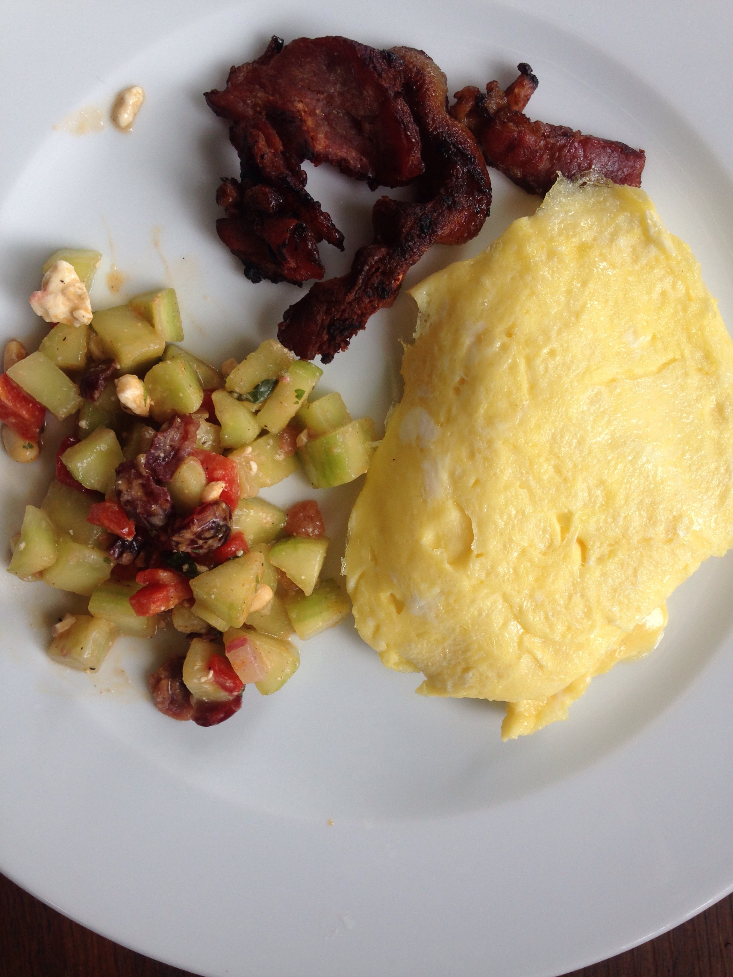 Broiled bacon, cucumber salad and egg omelette