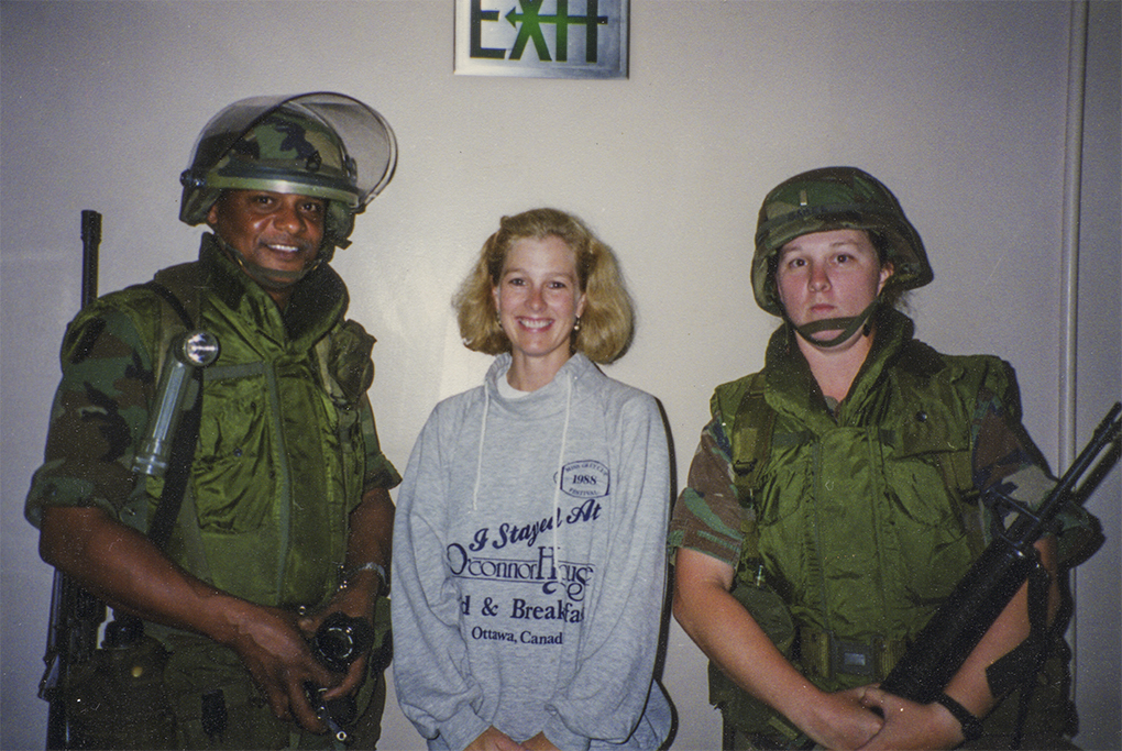 Under the exit sign backstage after the show with National Guards-on our return to the theatre.