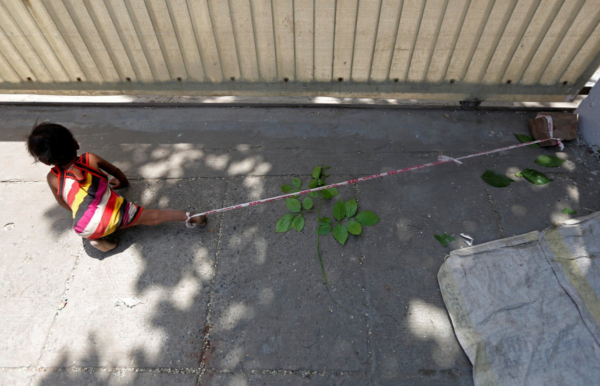 Indian baby tied up while mother works for survival