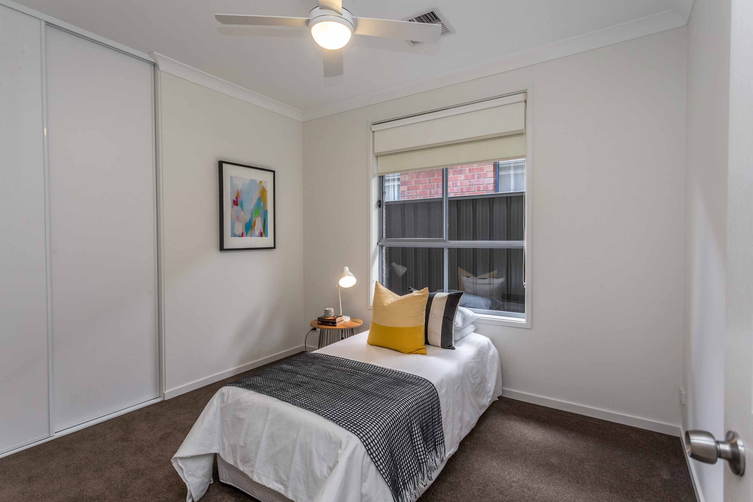 Generous bedroom with built-in robe