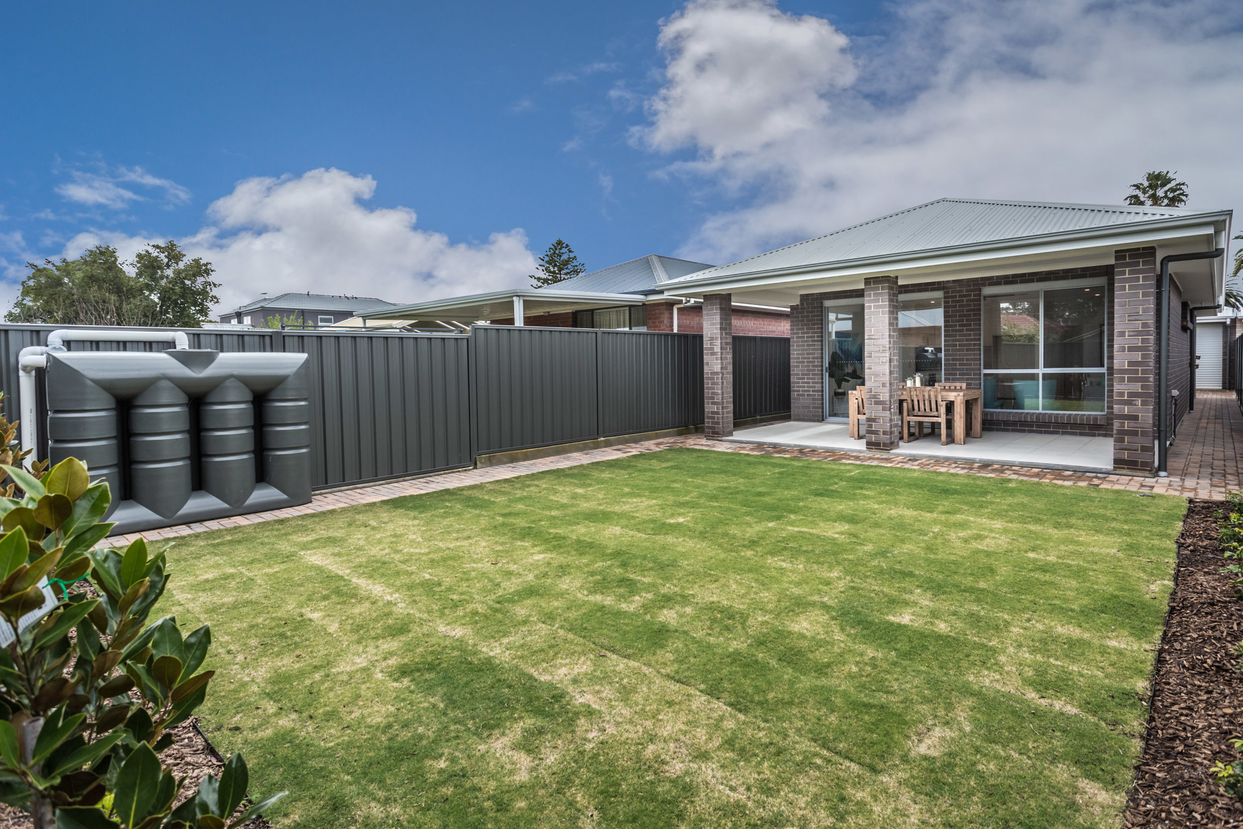 Lovely low maintenance back yard with all weather Alfresco