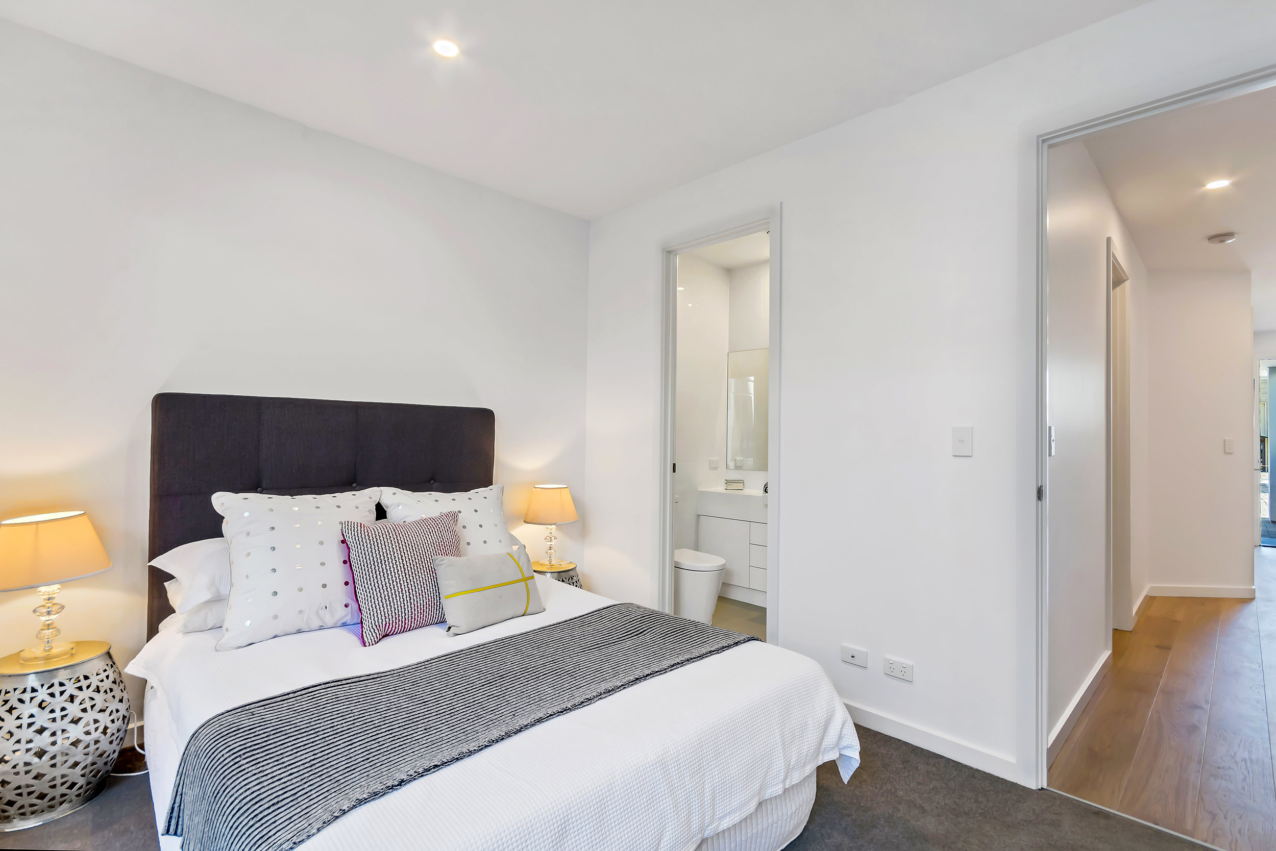 Bedroom 1 with floor to ceiling built-in robes, ensuite complete with Caesar stone and 2-pac vanity, opening to own private courtyard.