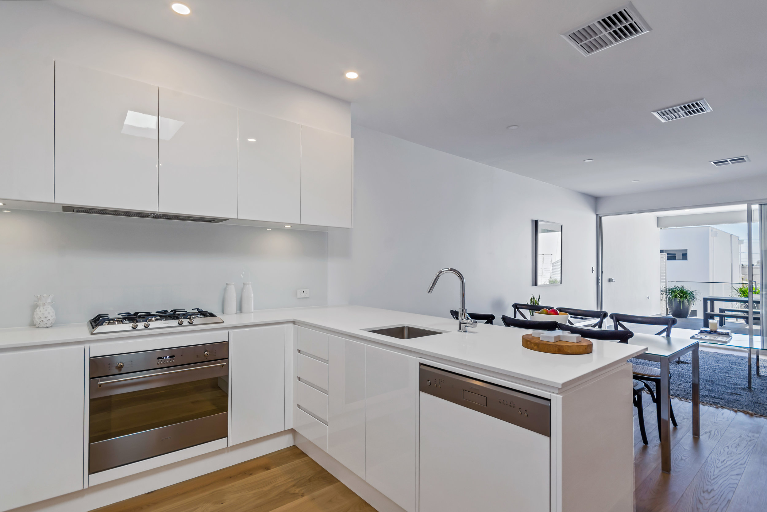 2-pac kitchen finished with Caesar stone bench tops, stainless steel Smeg appliances, over looking the sensational open living area