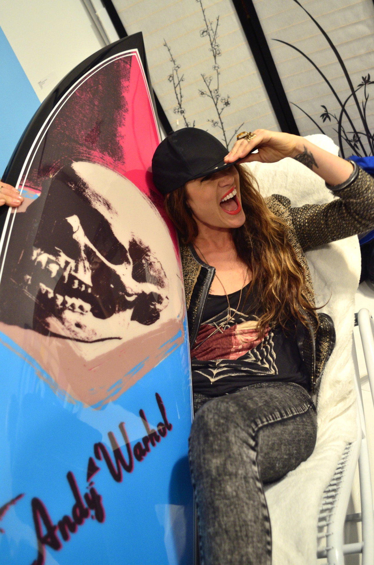 Having fun with a limited edition Andy Warhol surfboard by artist Tim Bessell at the Grand Opening of the SPiN Galleries in Chelsea, New York City.