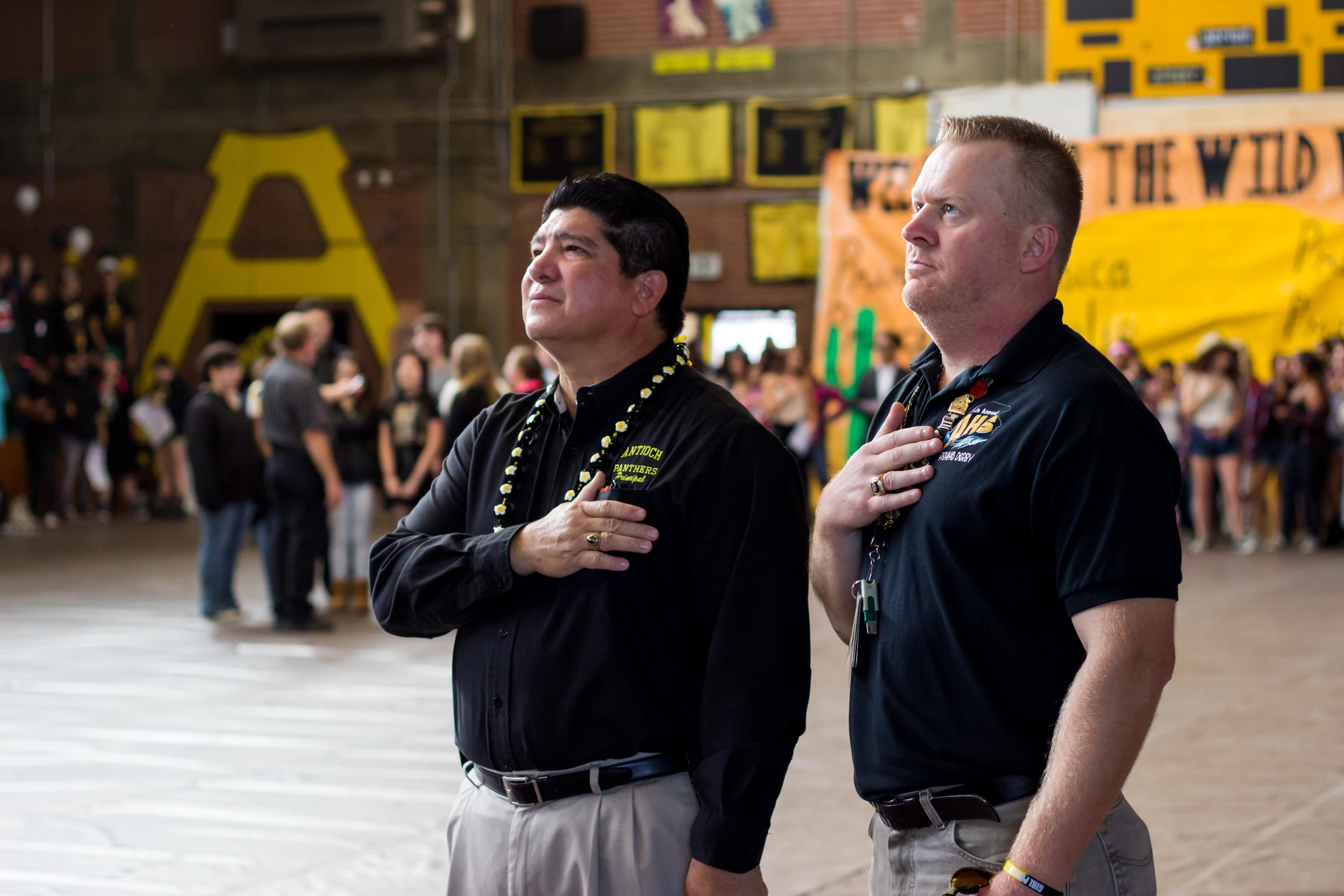 Mr. Mathews (right) with Principle Rocha (left) during the National Anthem at Antioch High's Class of 2015 Homecoming Rally.
