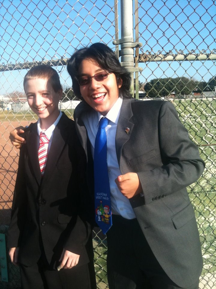 Mizrahy Aquino (left) and I on a December day dressed for a final presentation my freshmen year (2011).