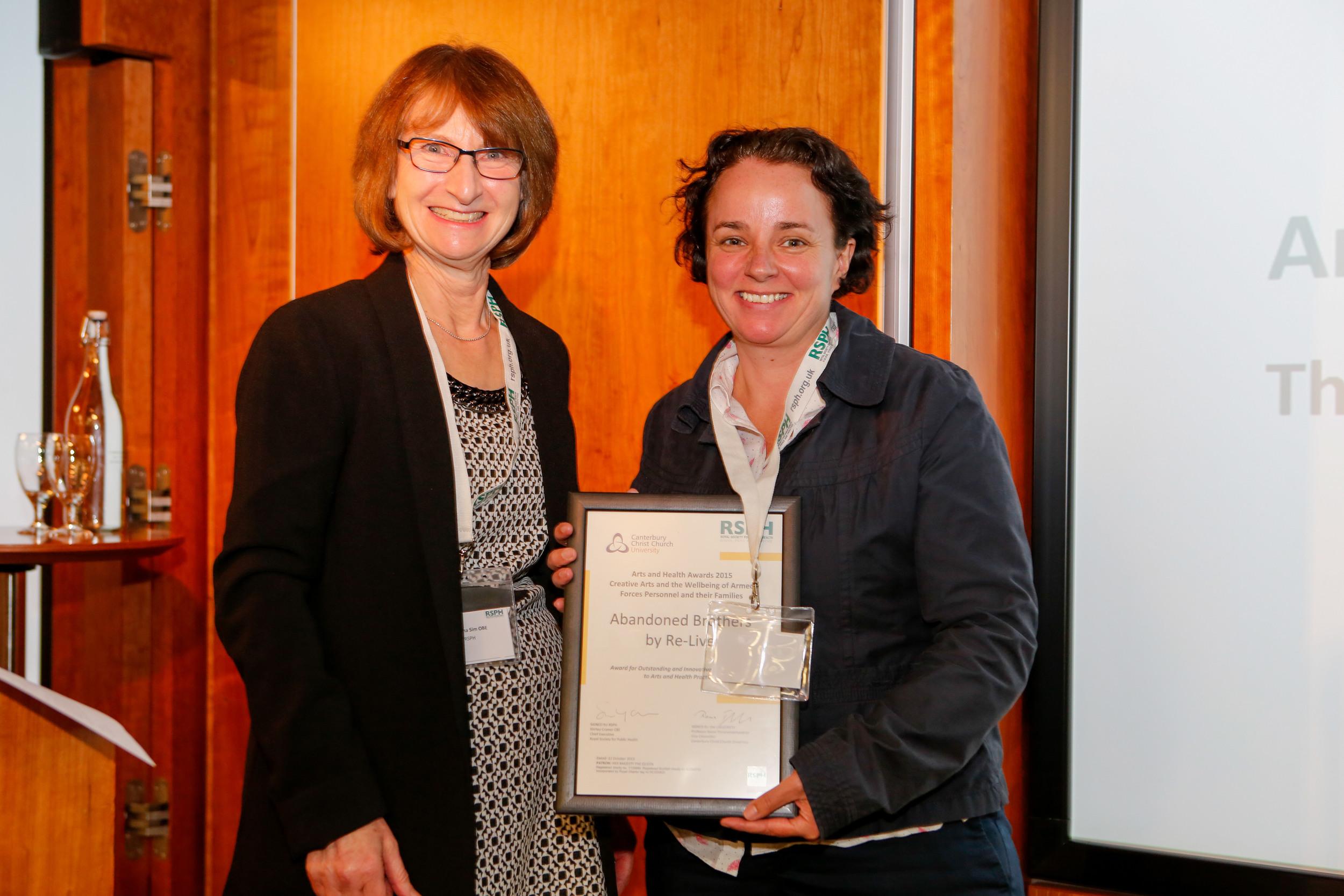 Sarah Belson receiving award on behalf of Re-Live