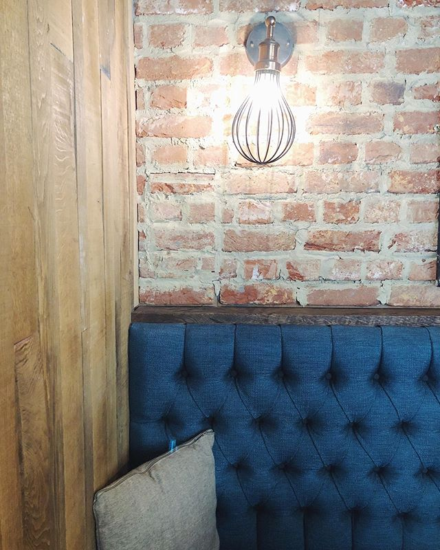 Loving the detail of brick with wood and strong blue fabrics.