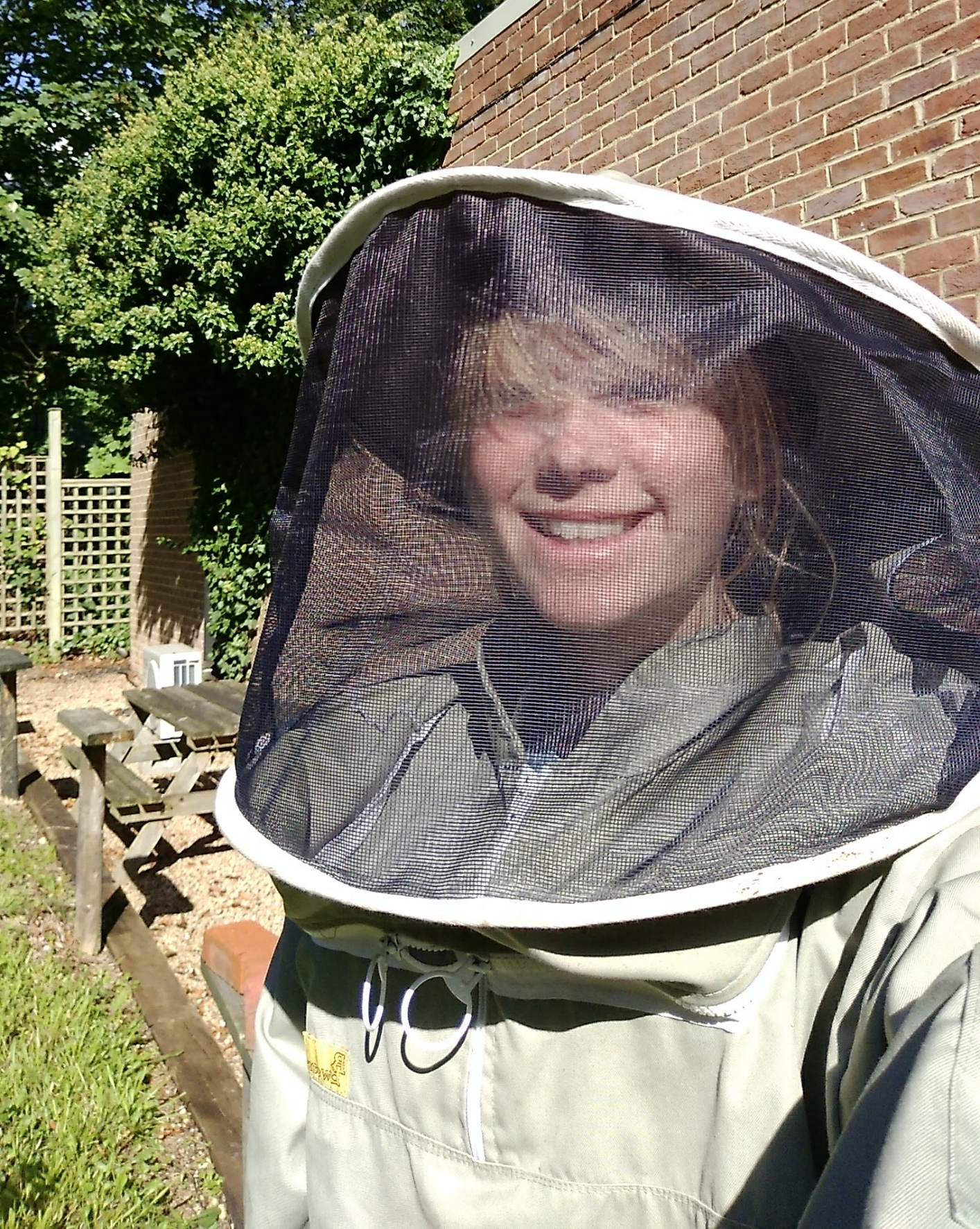 Georgia in a bee keeping suit