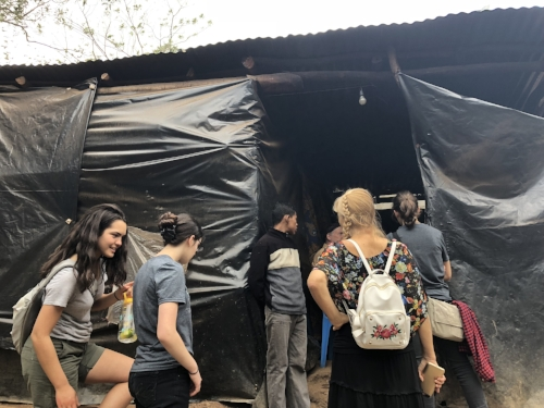 5 people live here. A home built of sticks and black plastic by the community that came together in love.