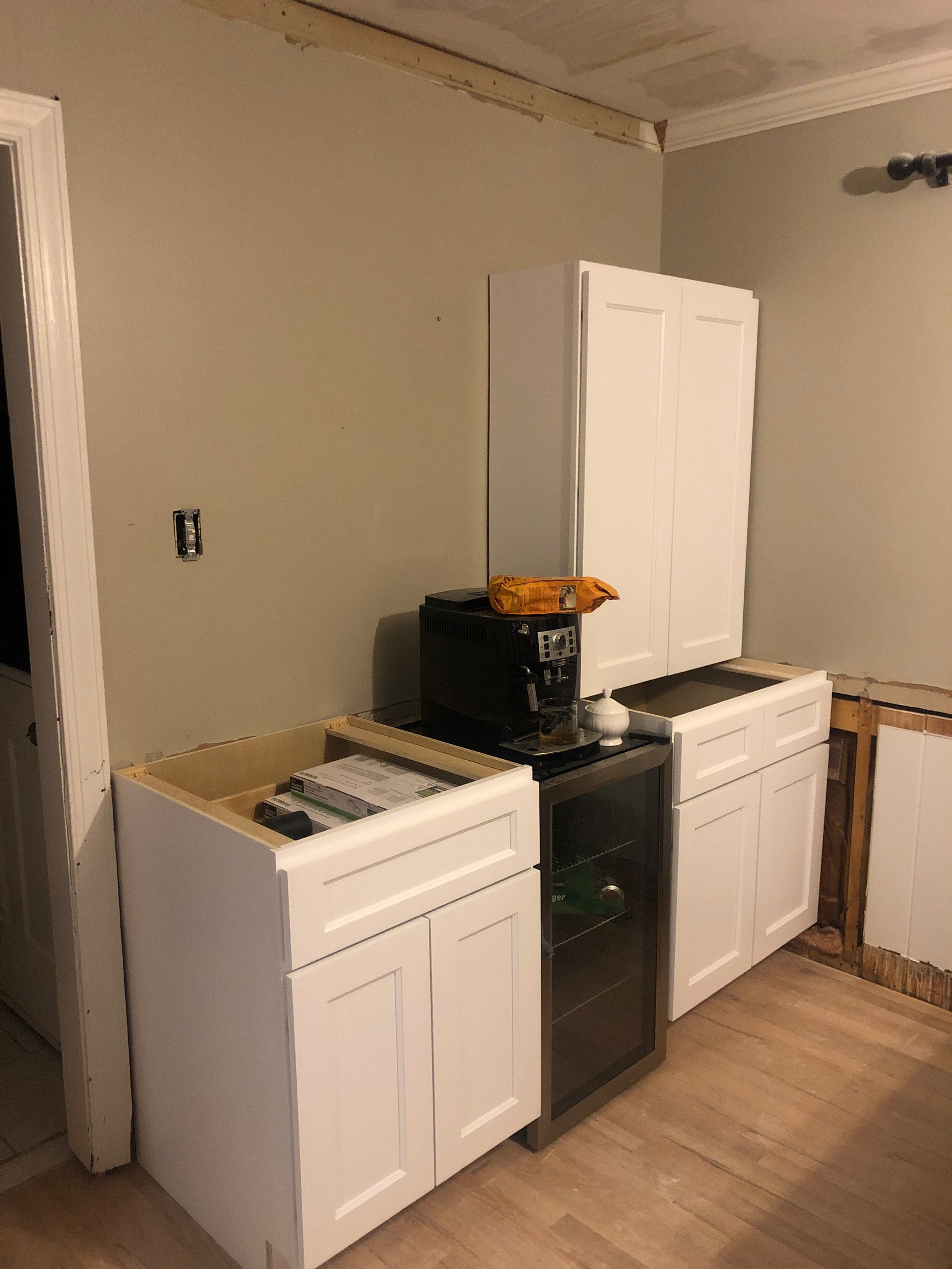 Who doesn't want more cabinet space?! We had a blank wall in the eat-in kitchen area, so we decided to make it the wet bar. Obviously, we didn't wait to plug the coffee maker back in!