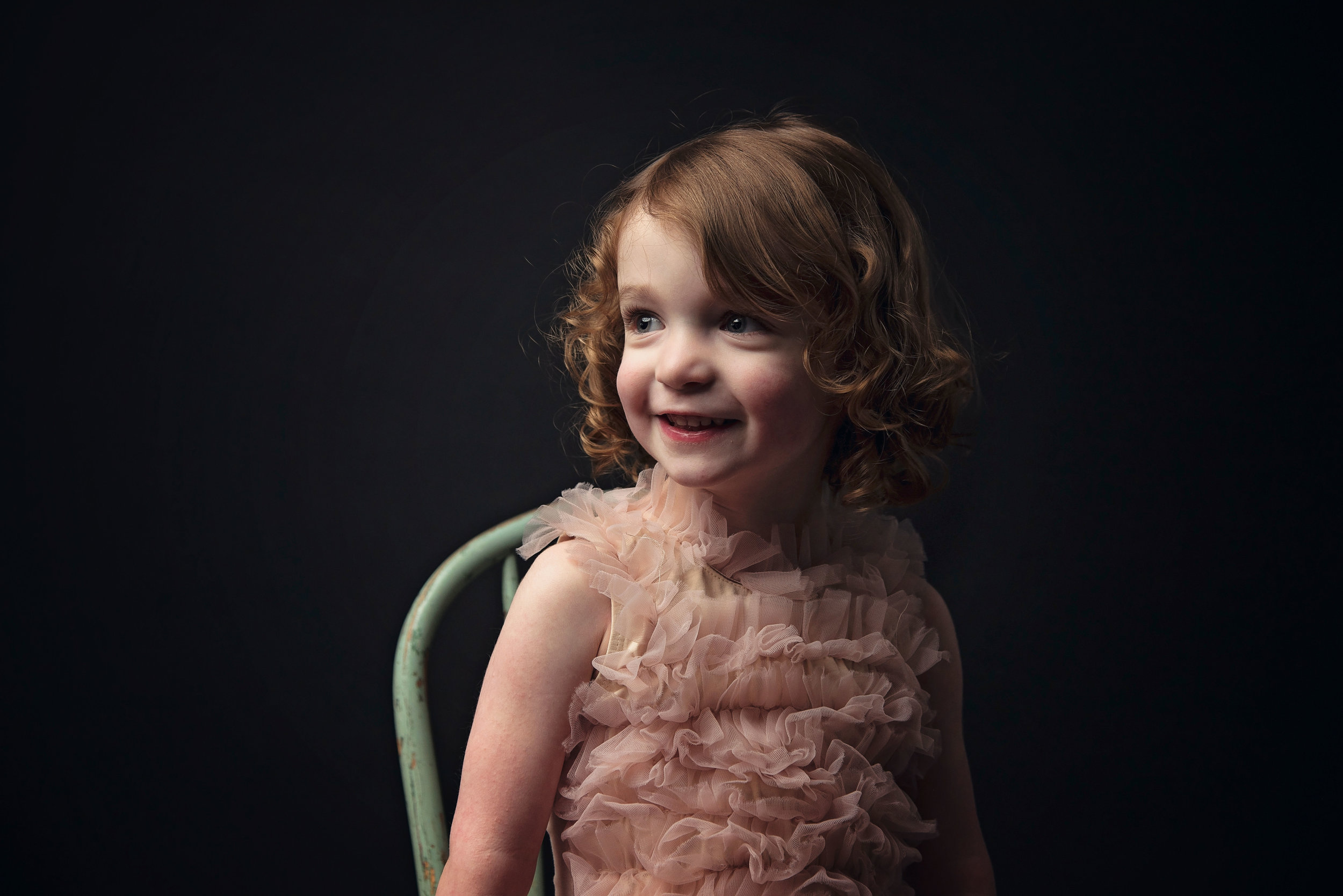 Young Girl in Pink Dress on Black Background Remember When Portraits Cincinnati Ohio