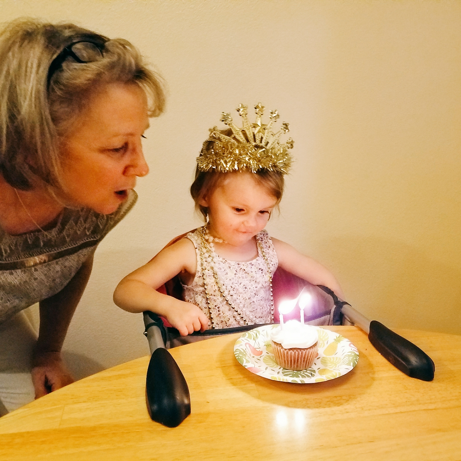 Happy birthday! She needed a little help from Gramma to blow out those candles