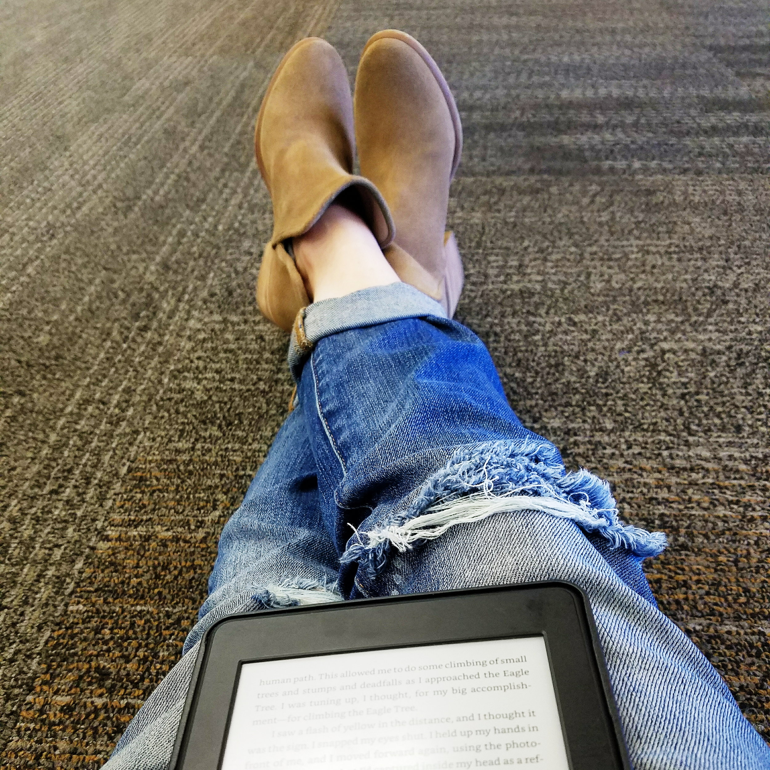 Delayed flight + tiny gate seating area = reading on the airport floor for 2 hours