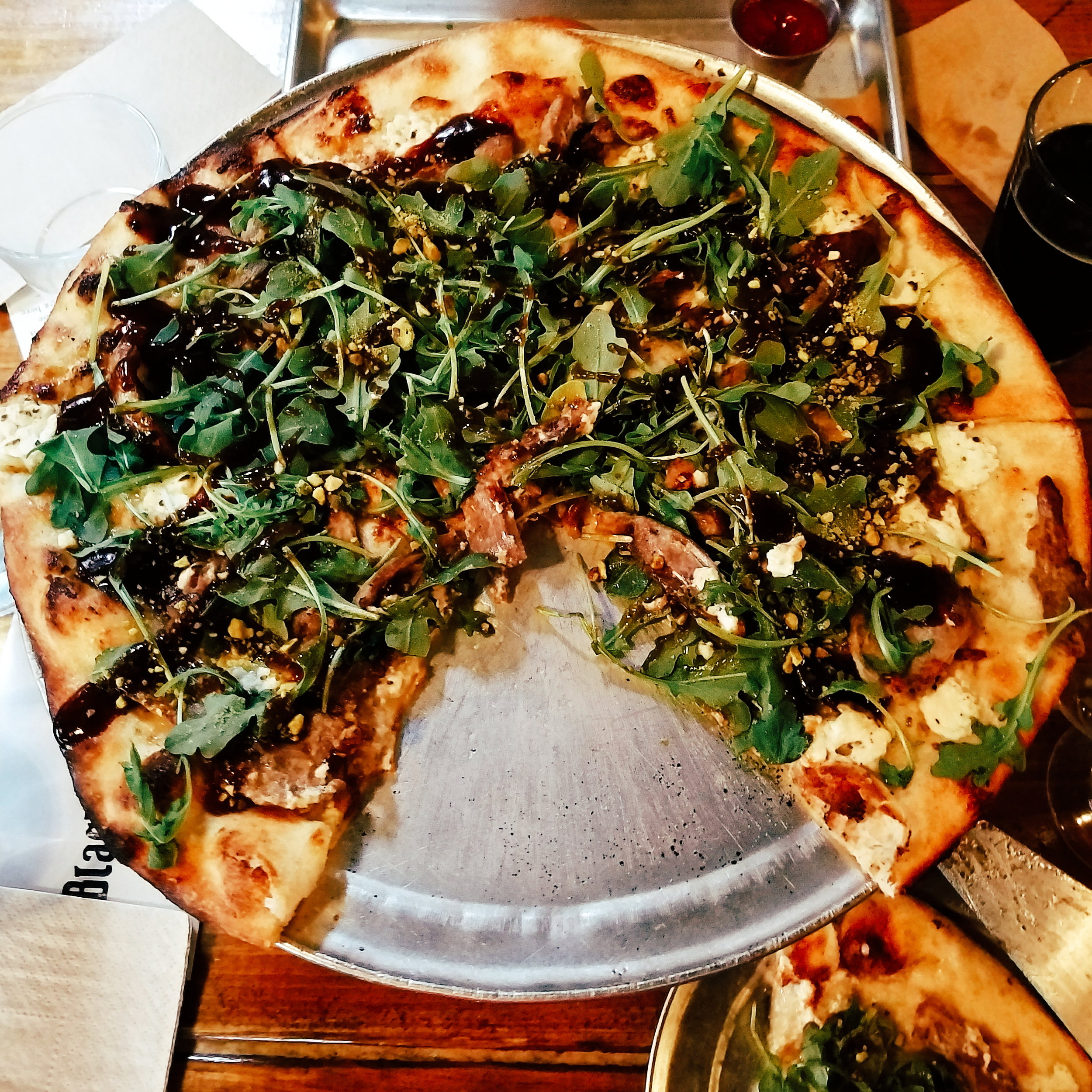 Black Duck Pizza - topped with smoked duck, goat cheese, pistachios, arugula, and a balsamic reduction. Possibly the best pizza I've ever eaten!