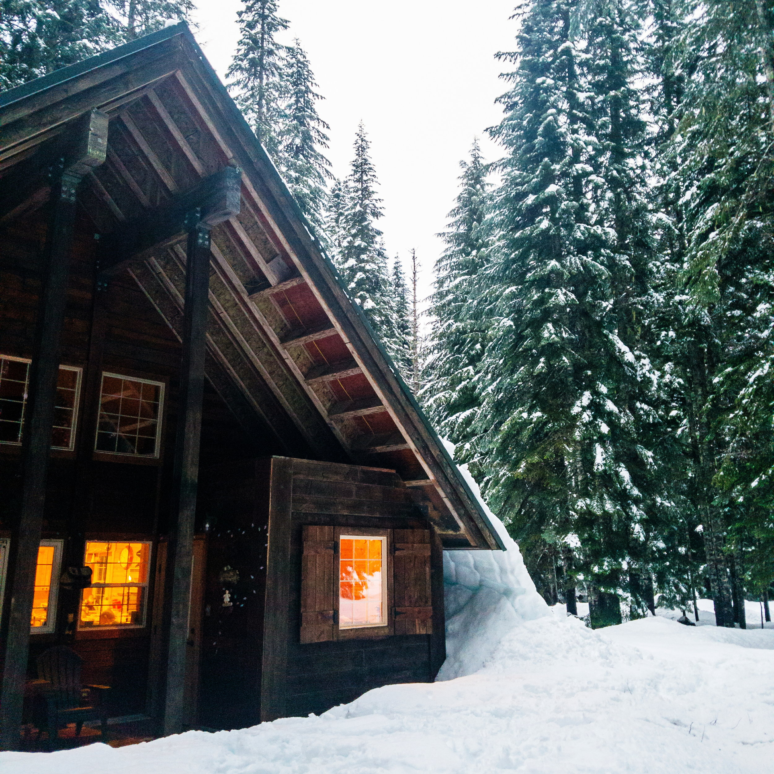 The cabin looks so cozy blanketed in snow!