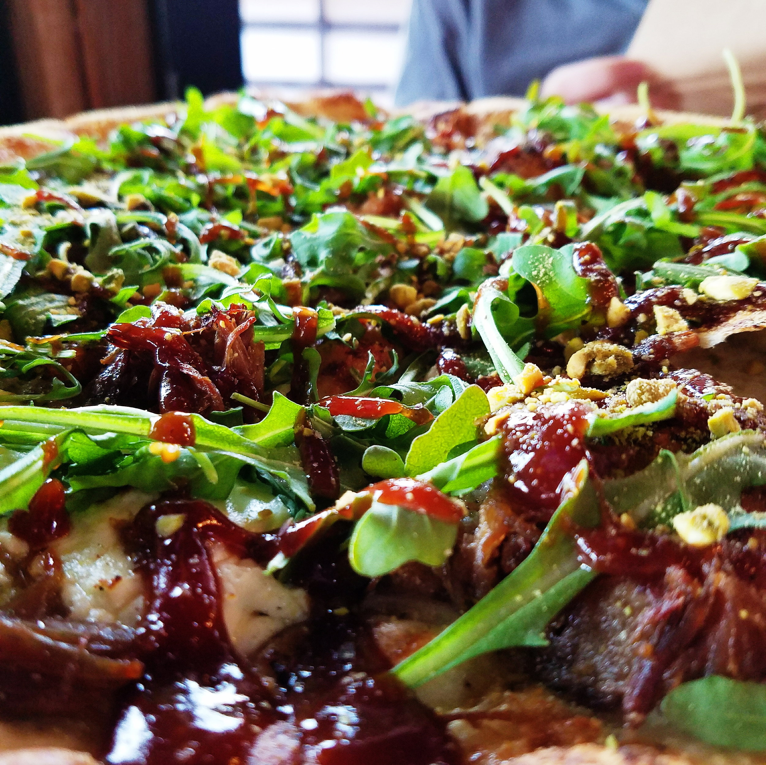 Possibly my favorite pizza of all time. Roast duck, arugula, pistachios, and goat cheese