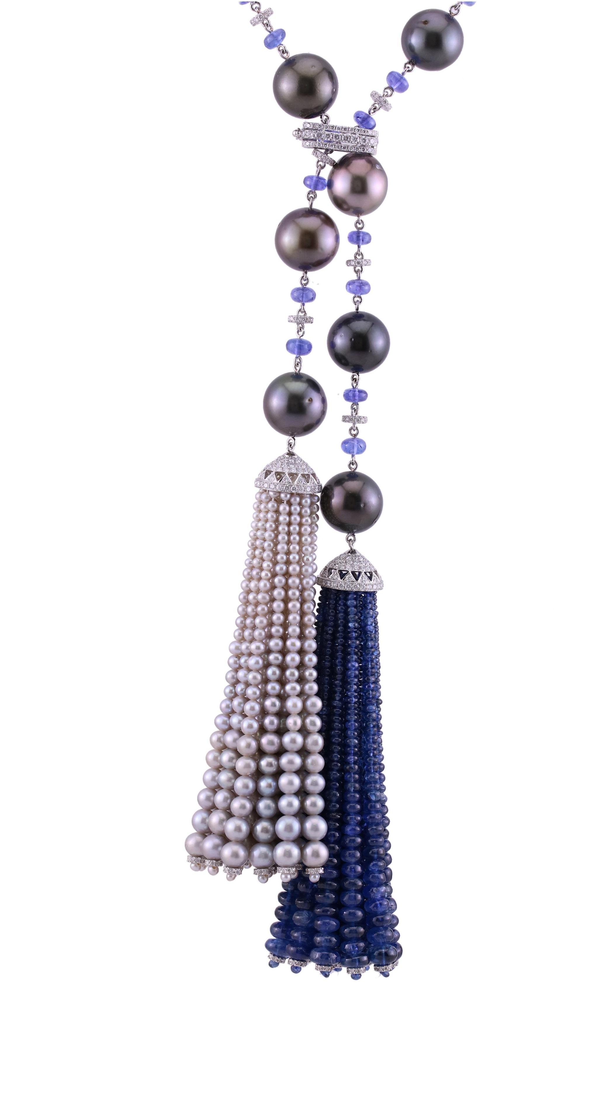 Stones:   -White Diamond Round Full Cut  -Emerald  -Grey Pearl  -Pearl Tahitian  -Tanzanite