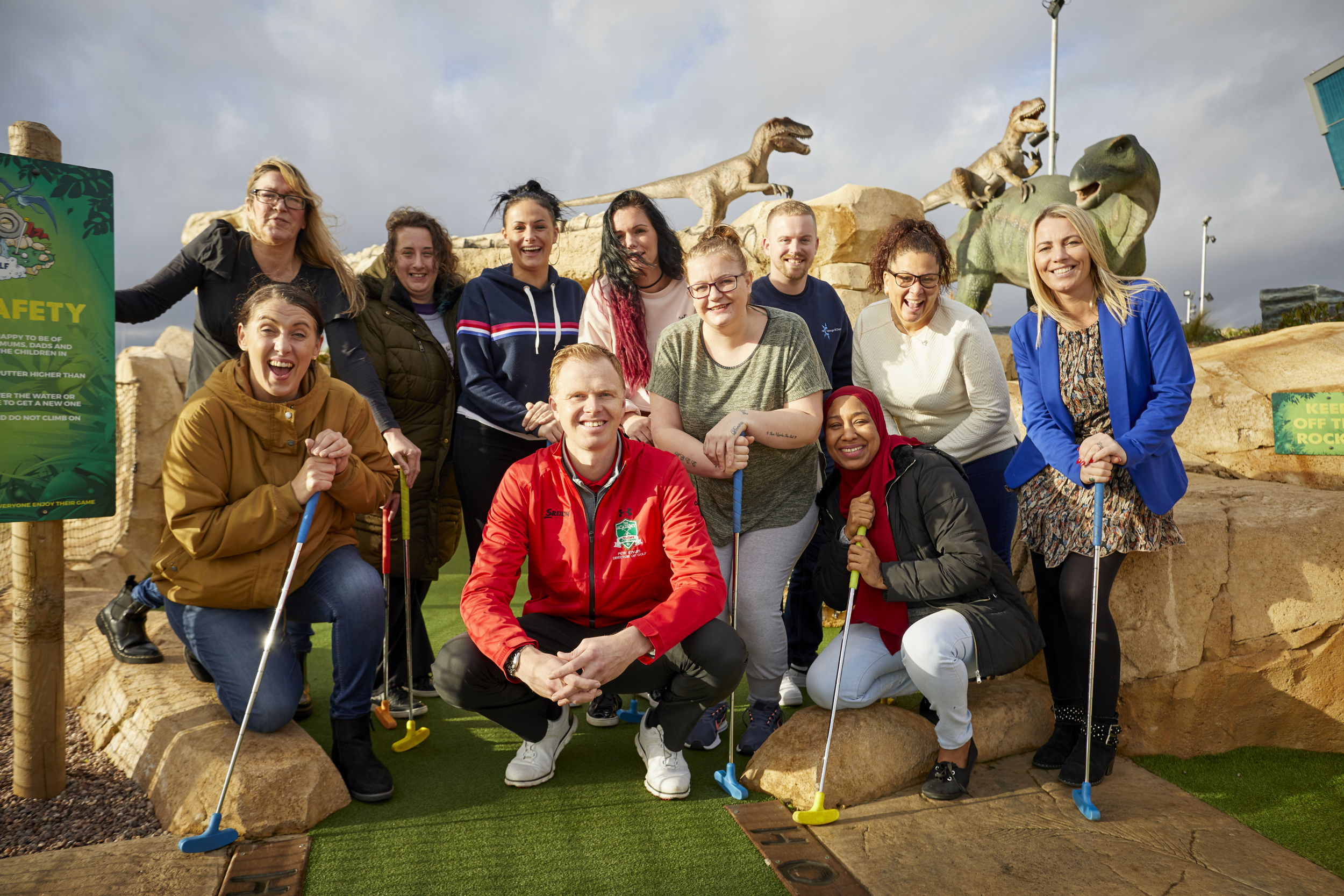 Community representatives join Pete Styles, director of golf, at Dino Falls and Trafford Golf Centre for a celebration of Dino Falls first birthday.