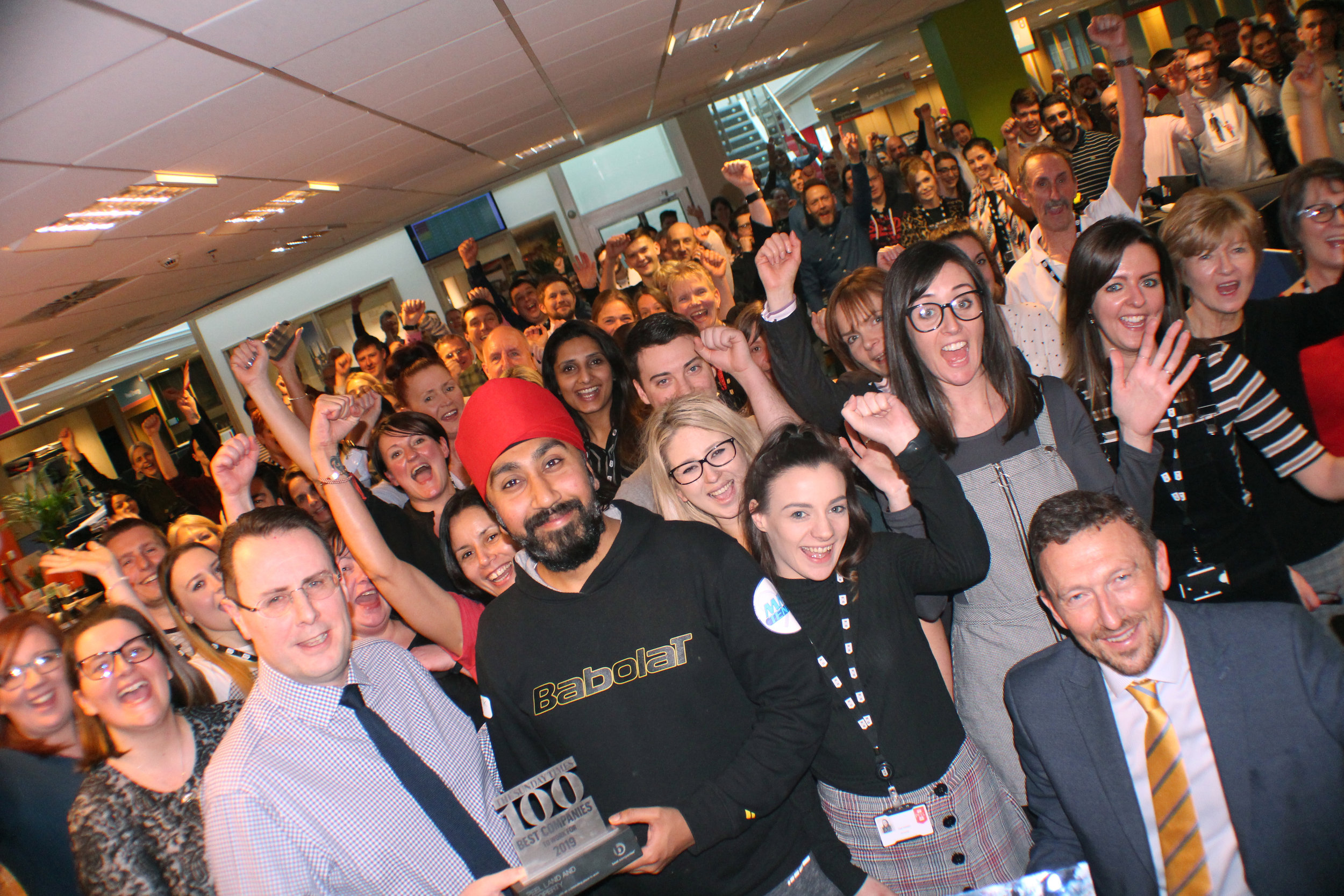 Peel L&P staff celebrate being number 79 on The Sunday Times top 100 companies to work for list.